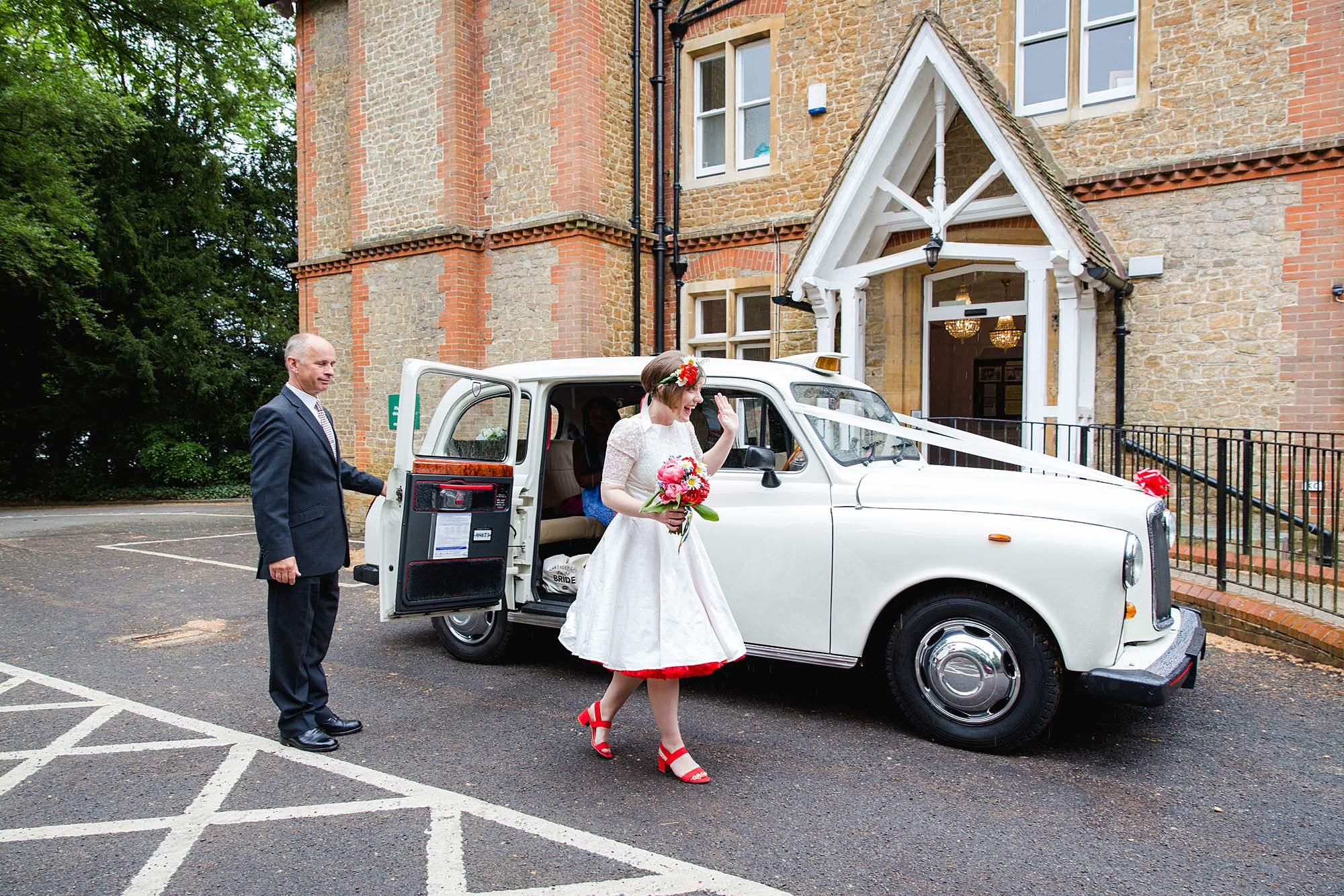 bride leaving taxi for wedding at guildfordregistry
