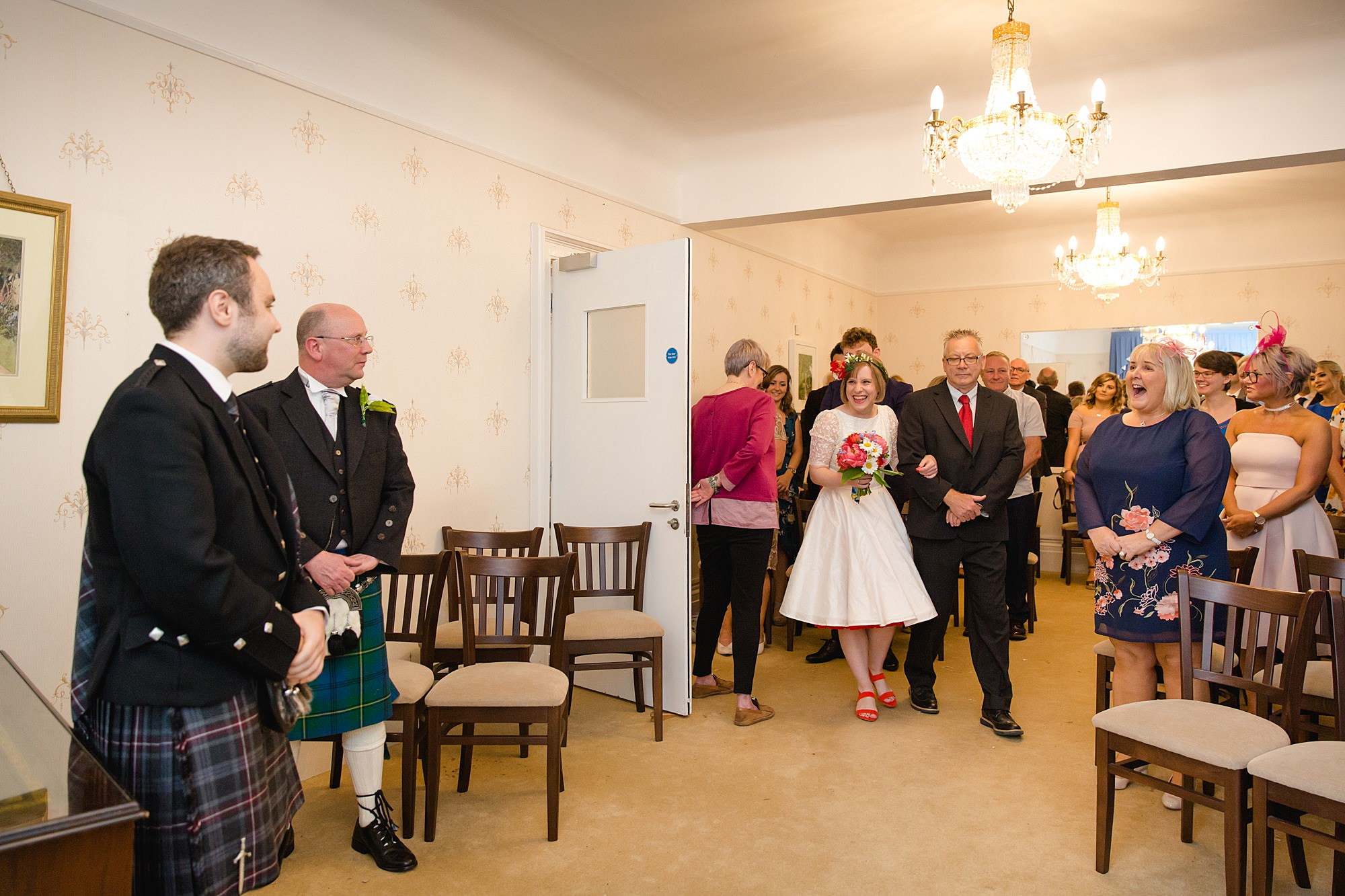 bride walking in to wedding ceremony at guildford register office