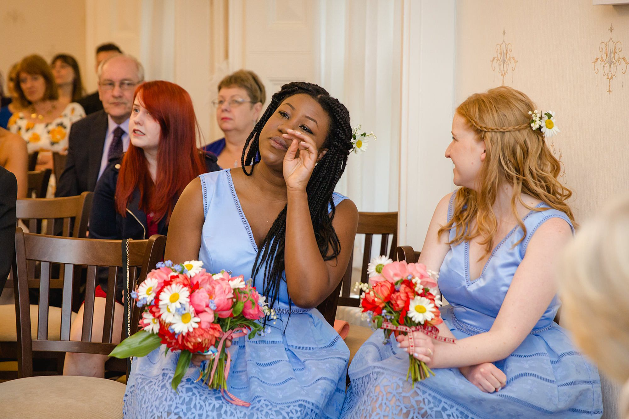 bridesmaid wipes away a tear in guildford wedding ceremony