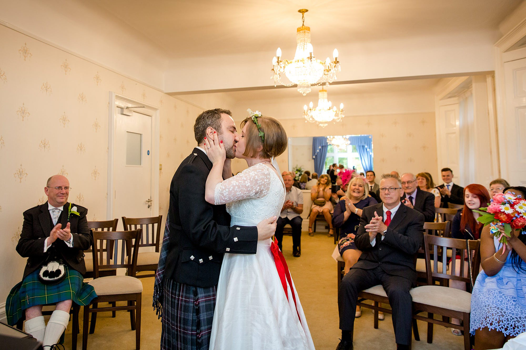 bride and groom first kiss at guildford register office wedding
