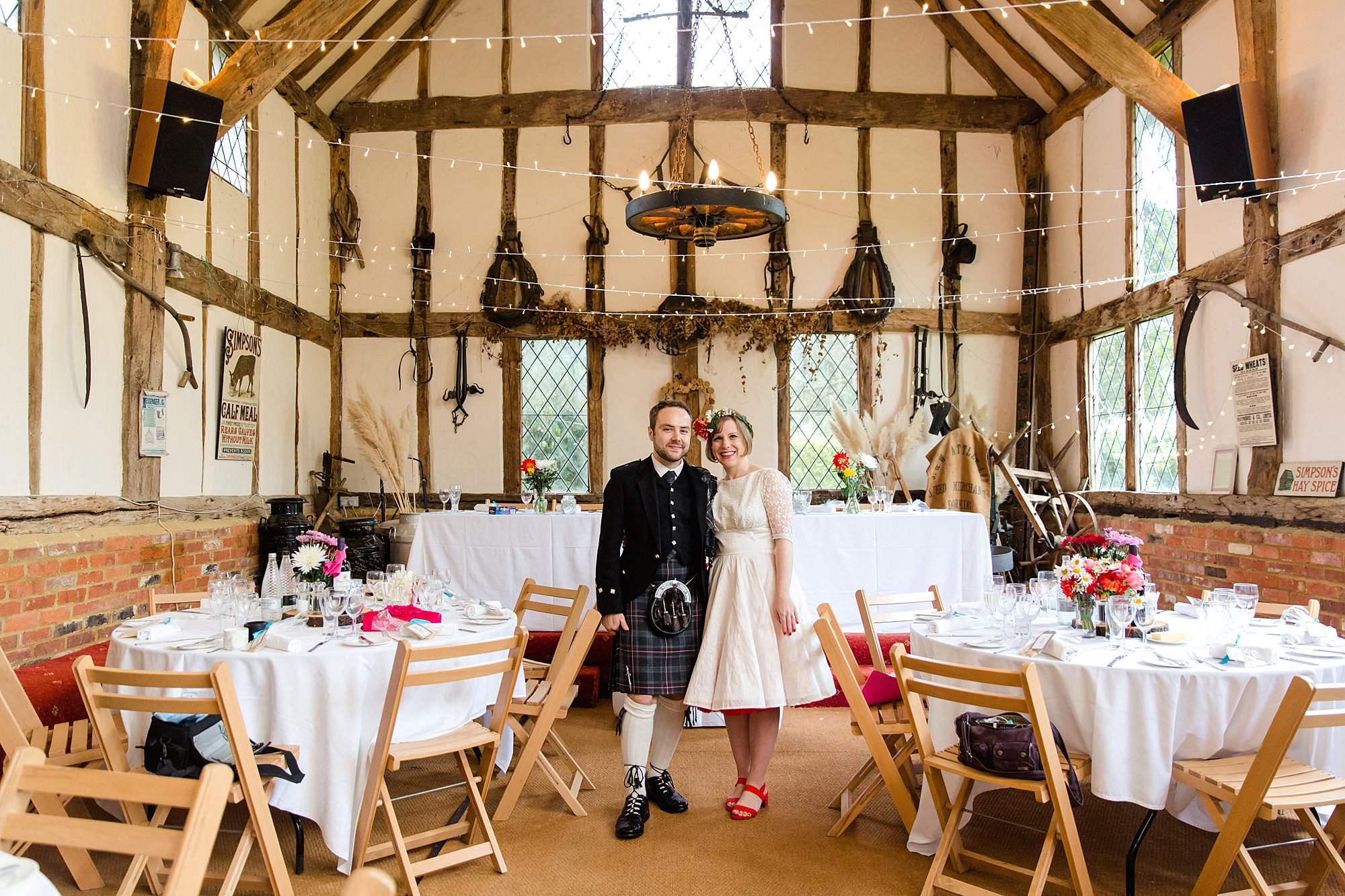 Fun DIY wedding bride and groom inside norwood farm barn