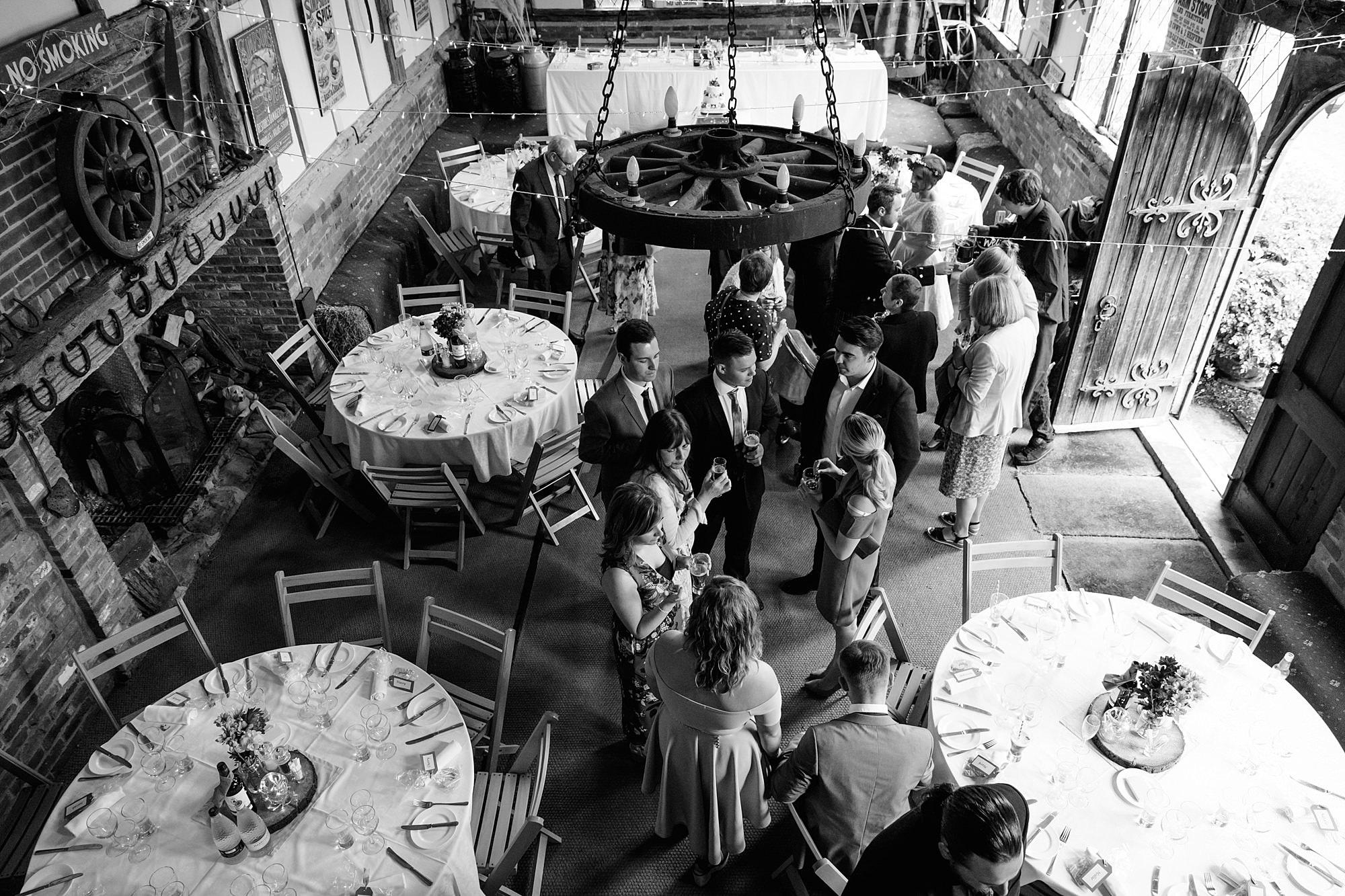 guests enjoying Fun DIY wedding reception in norwood farm barn