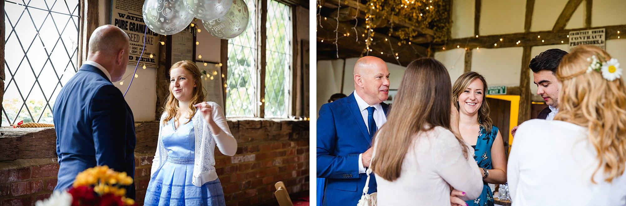 Fun DIY wedding guests chatting inside norwood barn