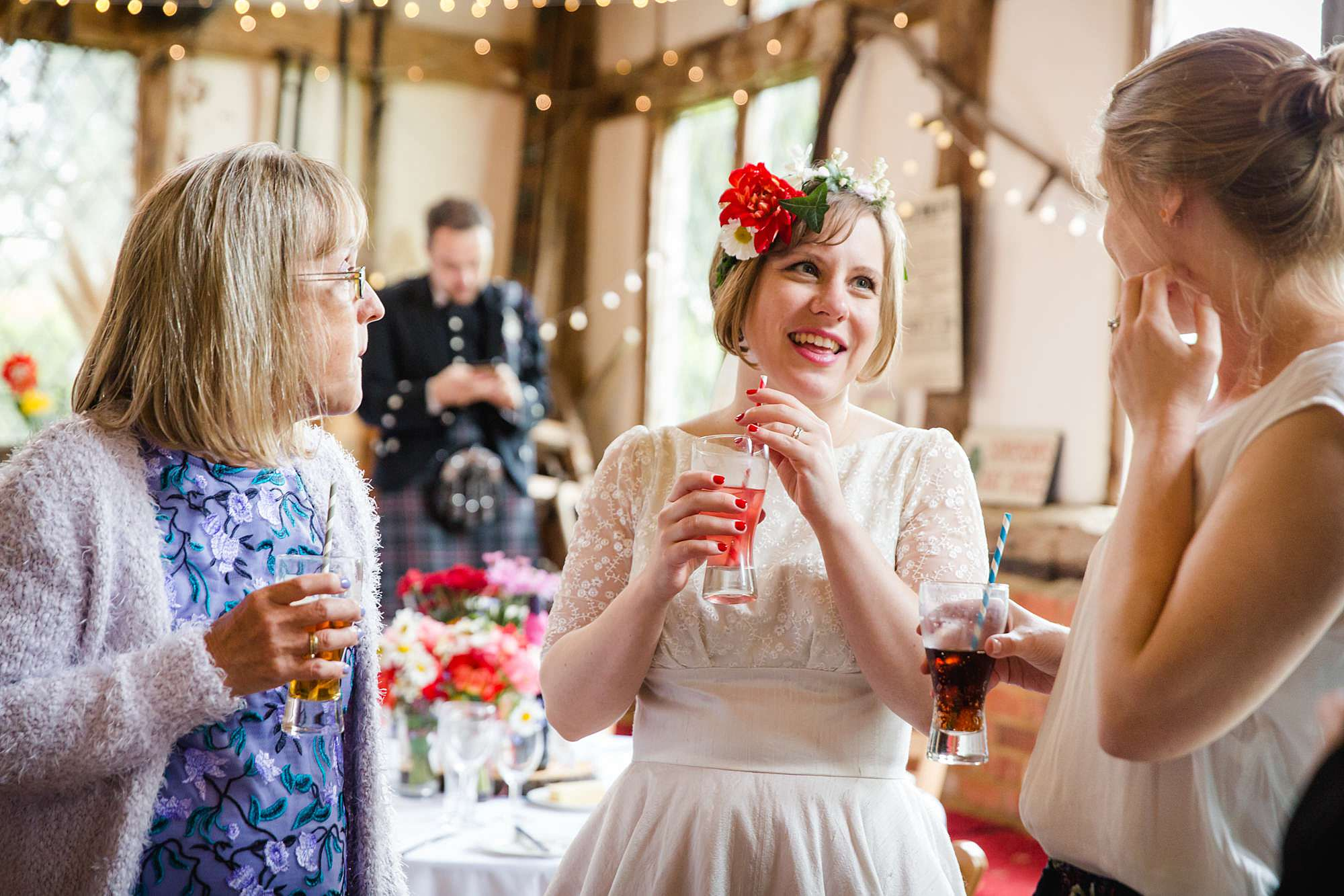 bride chats to guests during wedding reception at norwood farm