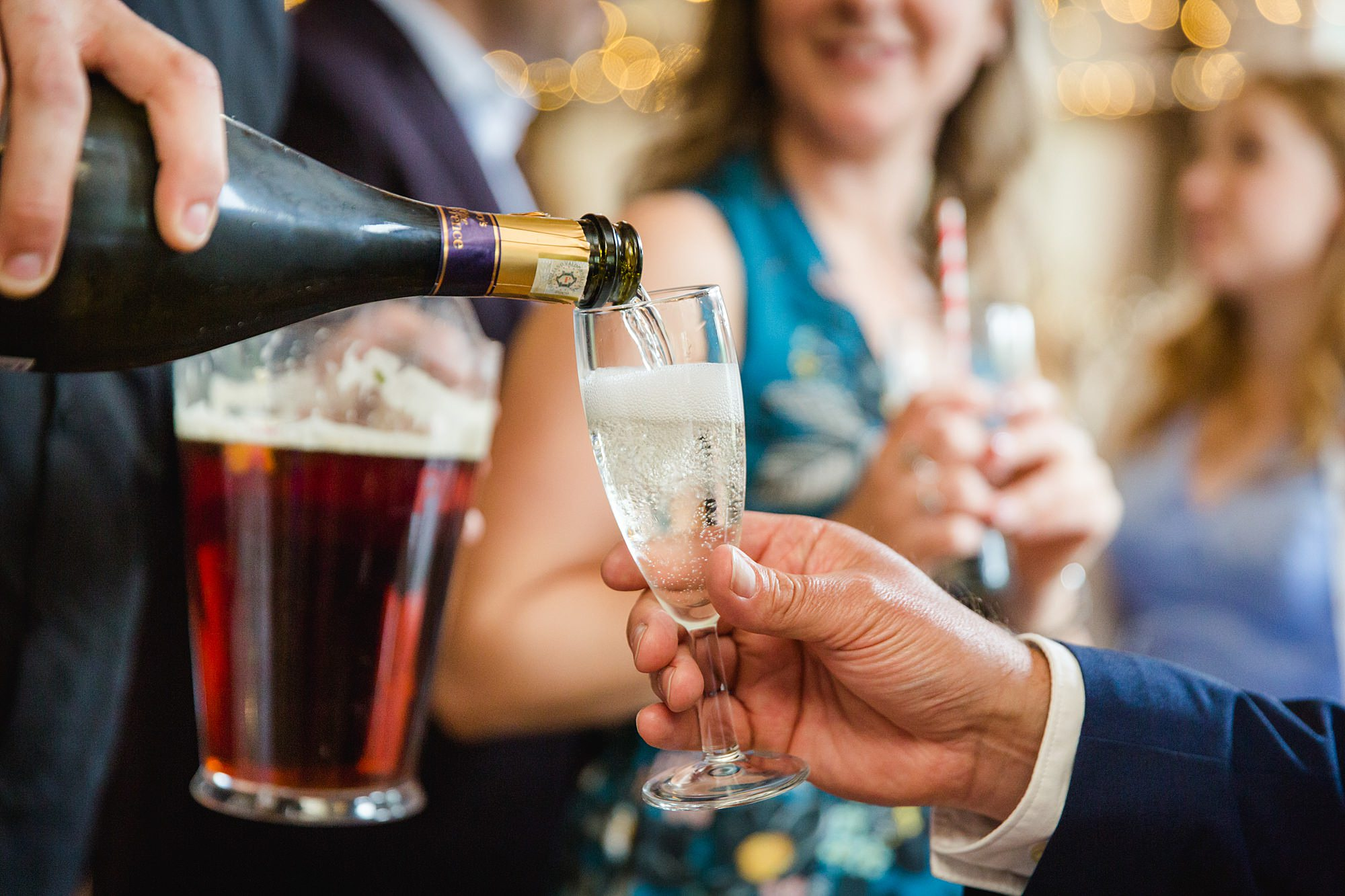 champagne poured into a glass at norwood farm wedding