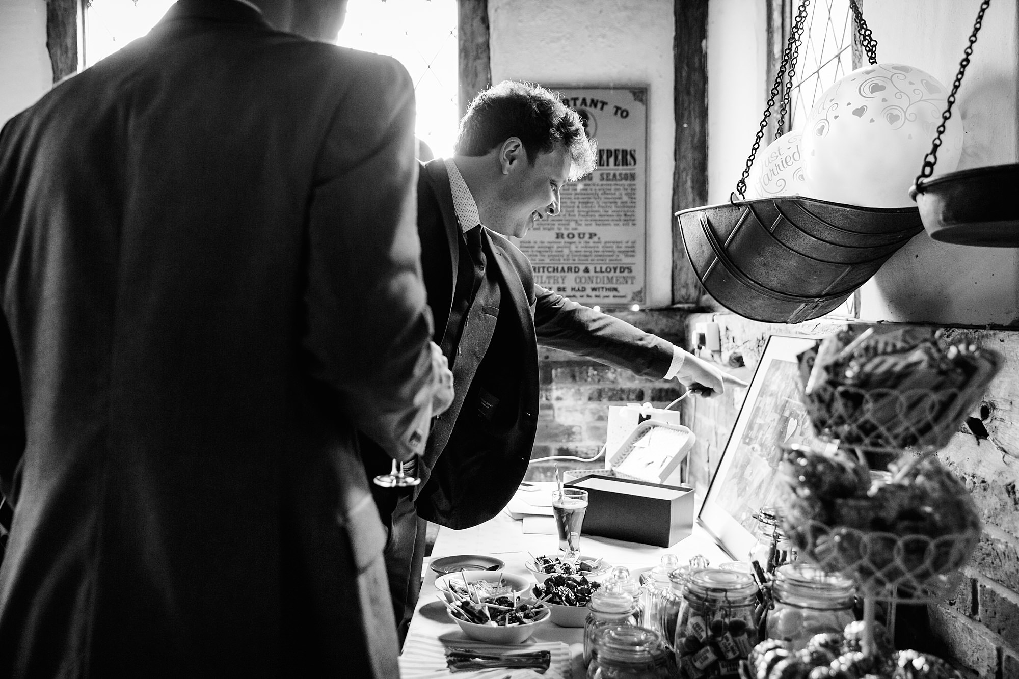 wedding guest looking at past photos of bride and groom