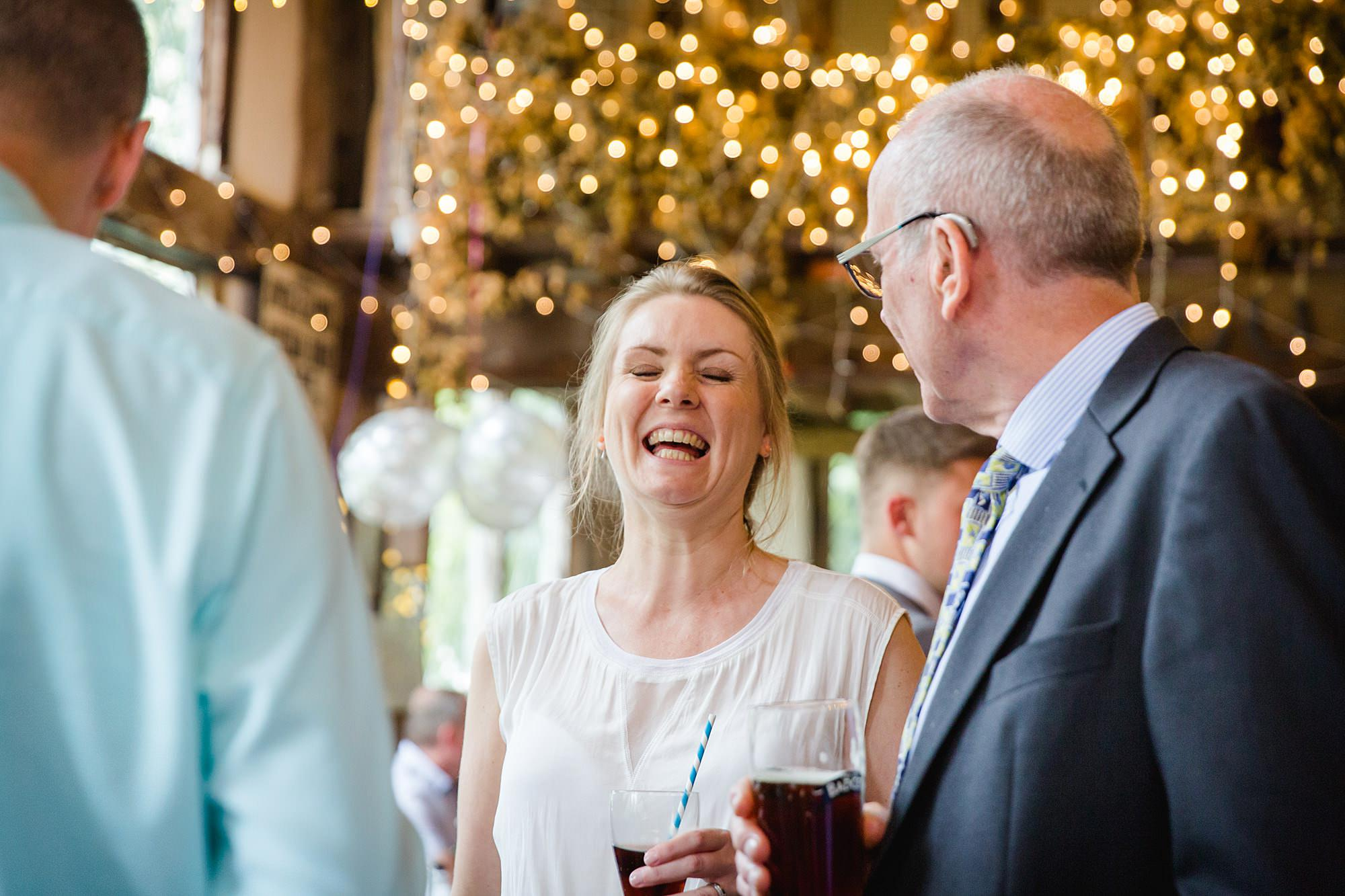 guest laughs during drinks reception at norwood farm