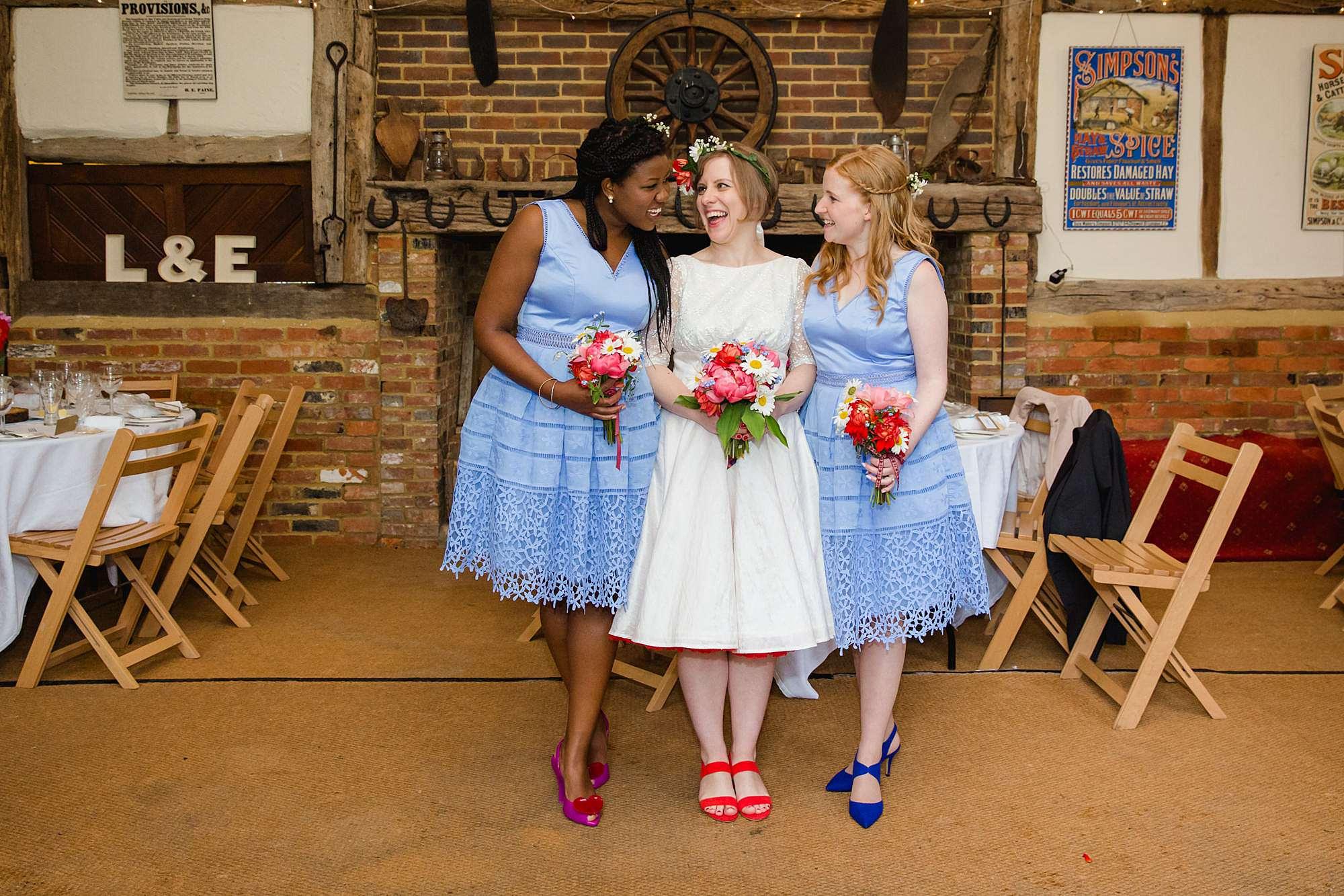 Fun DIY wedding bride and bridesmaids in norwood barn