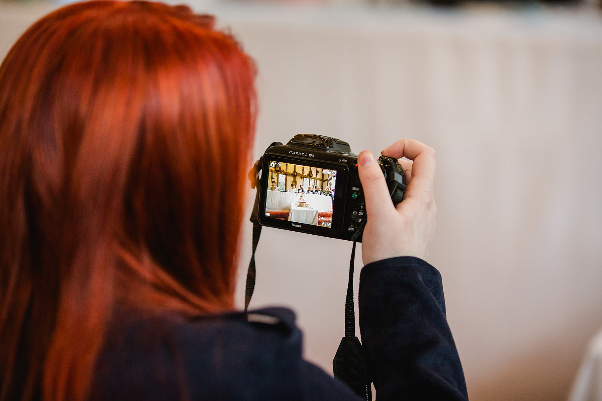 Fun DIY wedding guest taking picture of speeches