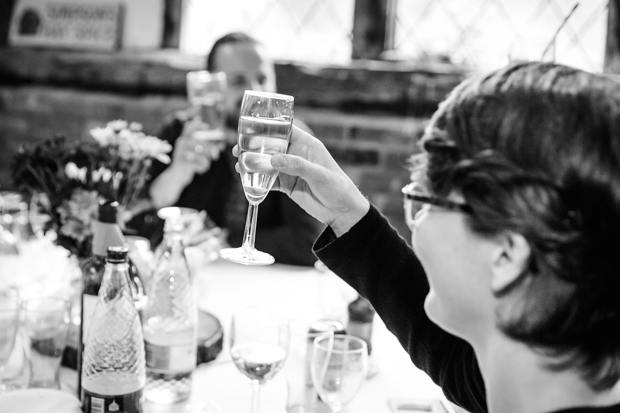 Fun DIY wedding guests raise glasses together in a toast