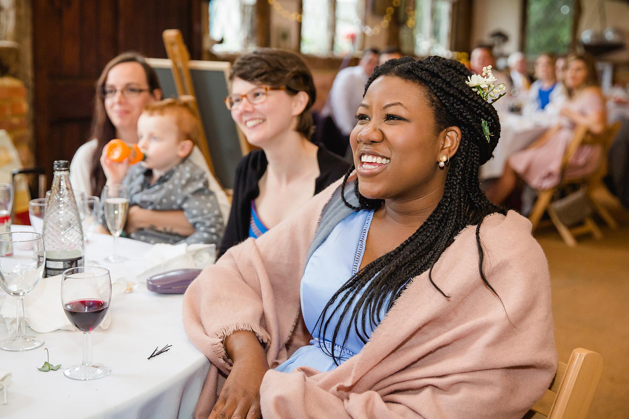 Fun DIY wedding bridesmaid listening to groom's speech