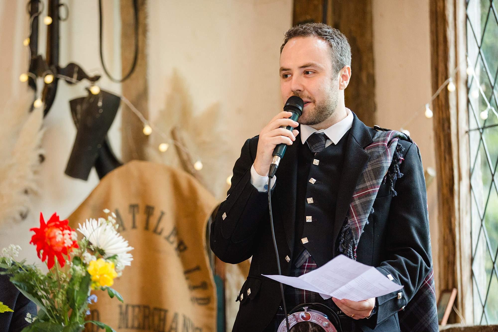 groom giving speech at norwood farm wedding