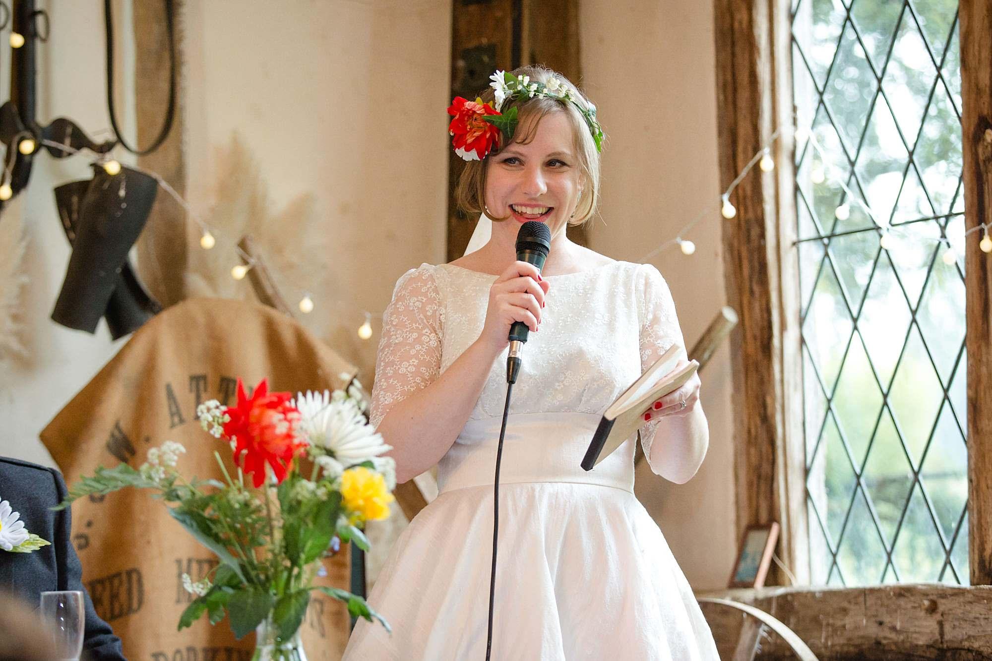 bride gives a speech at Fun DIY wedding