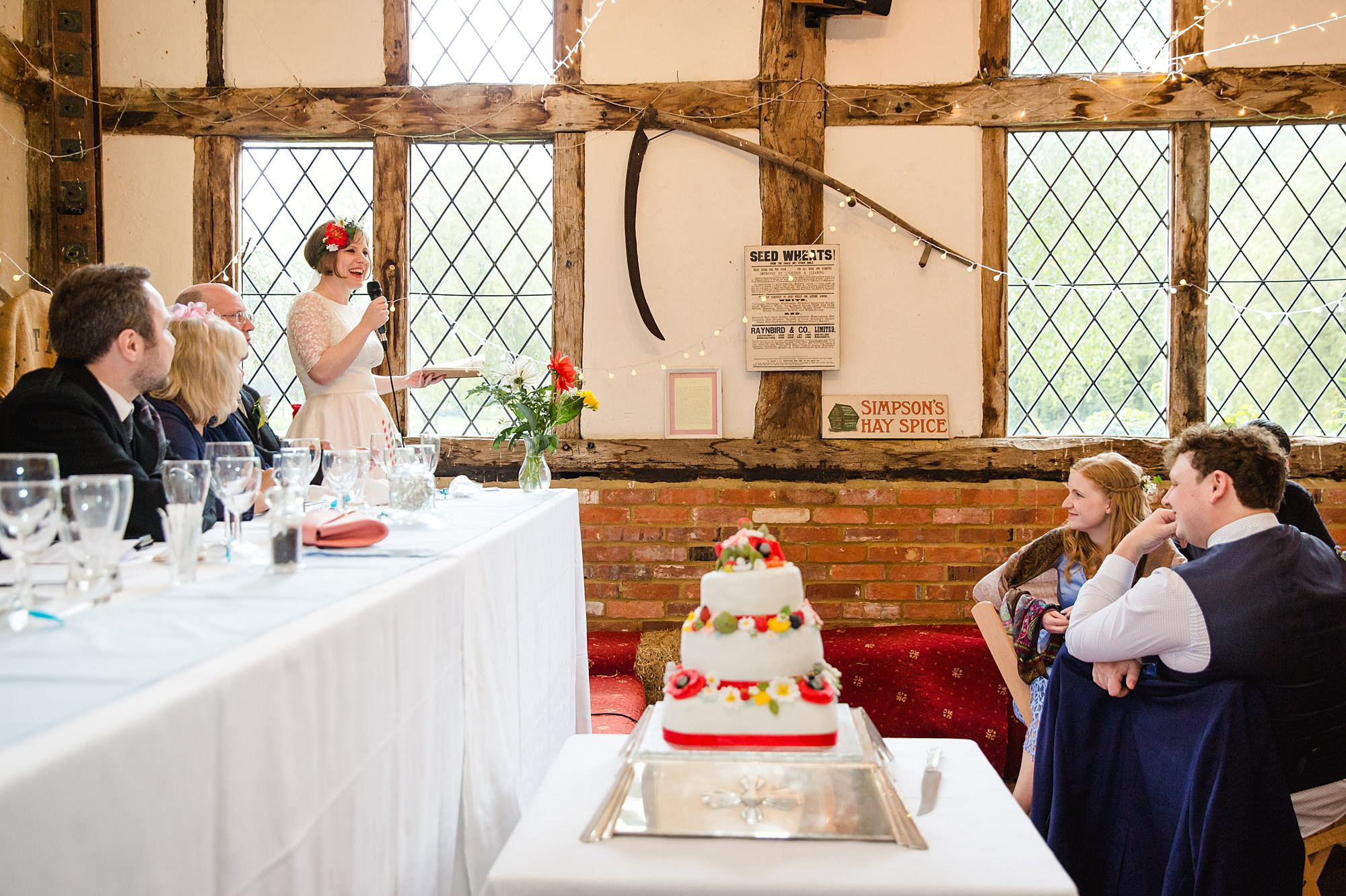 guests listen to bride giving speech at Fun DIY wedding