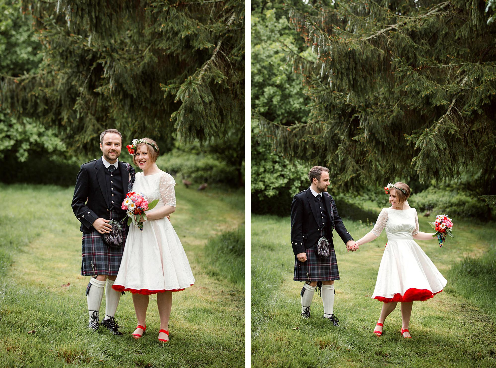 bride and groom stand together by trees in grounds of norwood farm