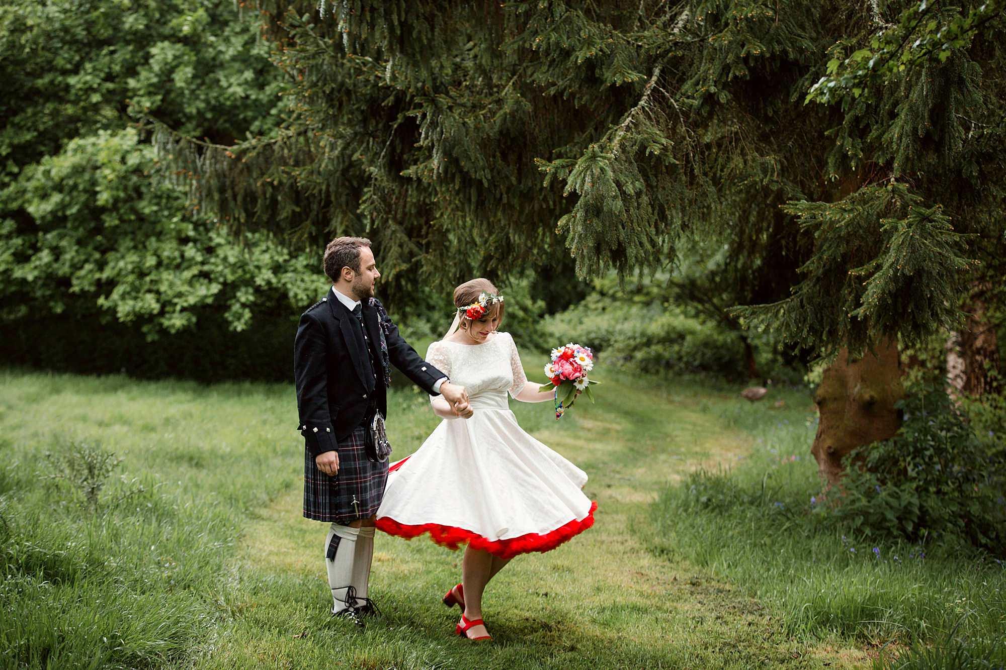 Fun DIY wedding groom twirls his bride in gardens at norwood farm wedding