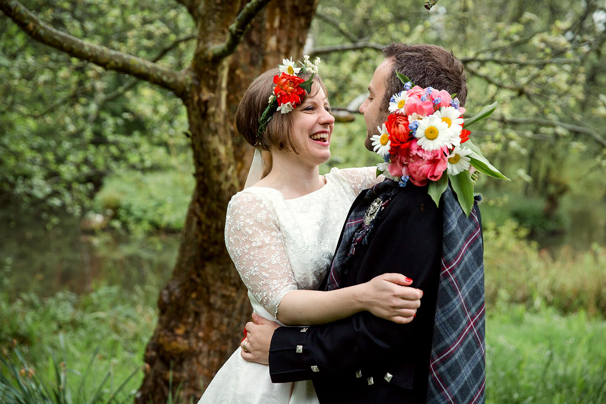 bride laughing at groom in gardens