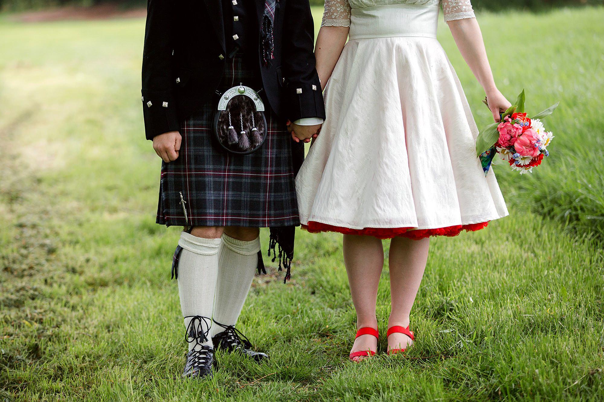 close up of bride's skirt and groom's kilt at Fun DIY wedding