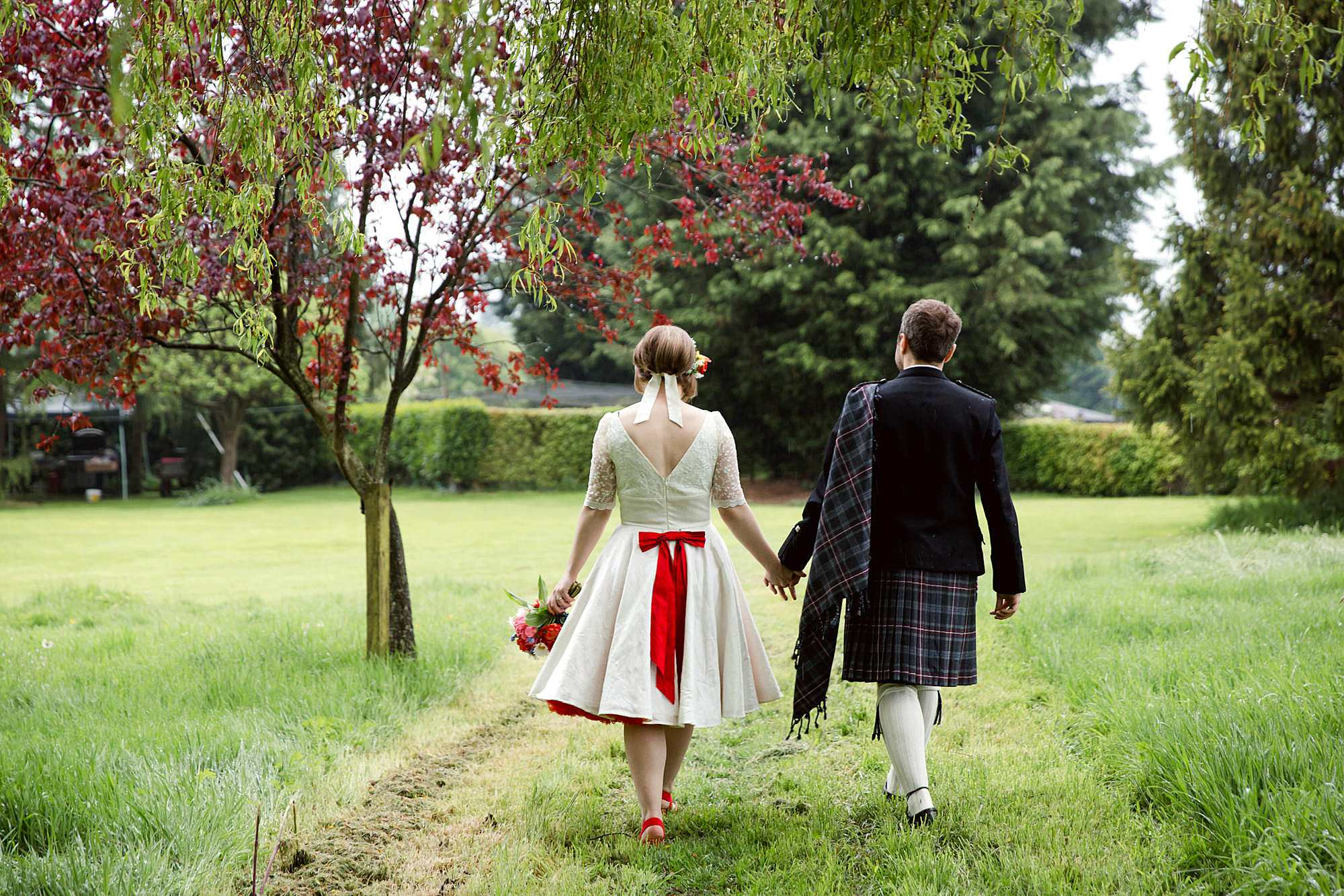 bride and groom walking through grounds at norwood farm