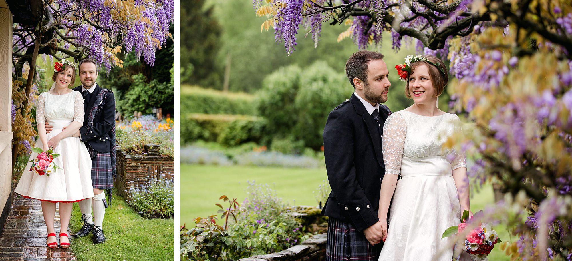 Fun DIY wedding bride and groom by wisteria flowers