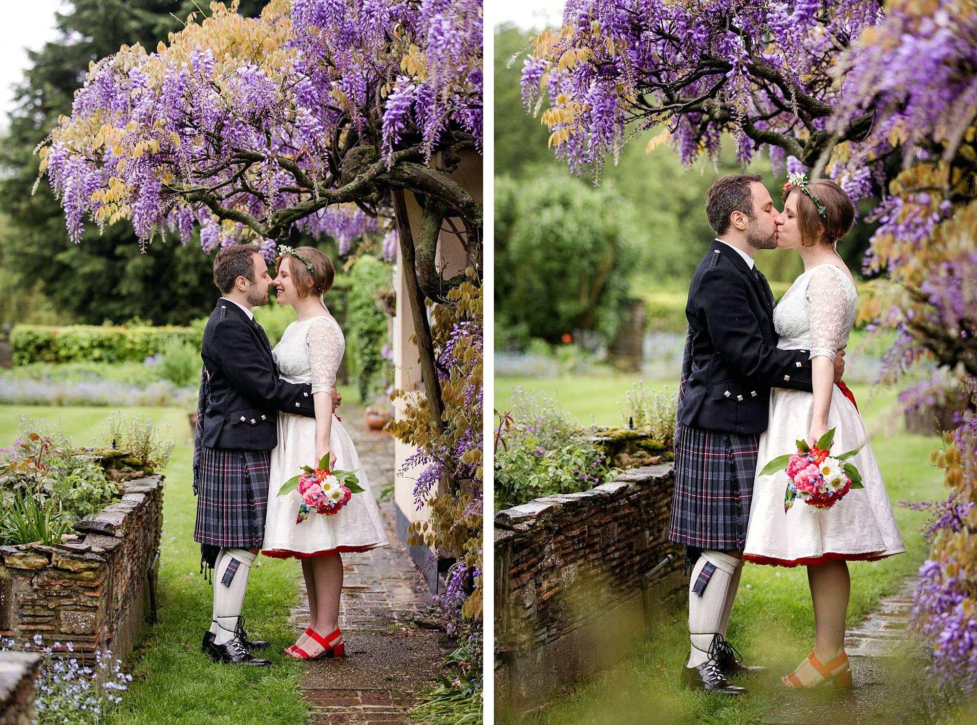 bride and groom kiss under wisteria wt Fun DIY wedding