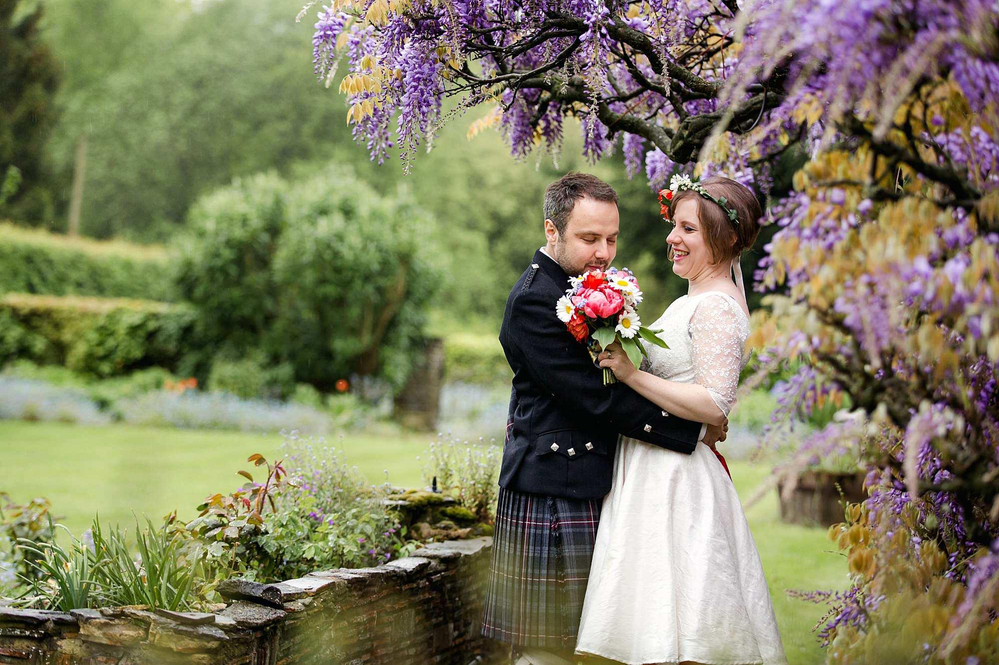 groom smells bride's bouquet at norwood farm wedding