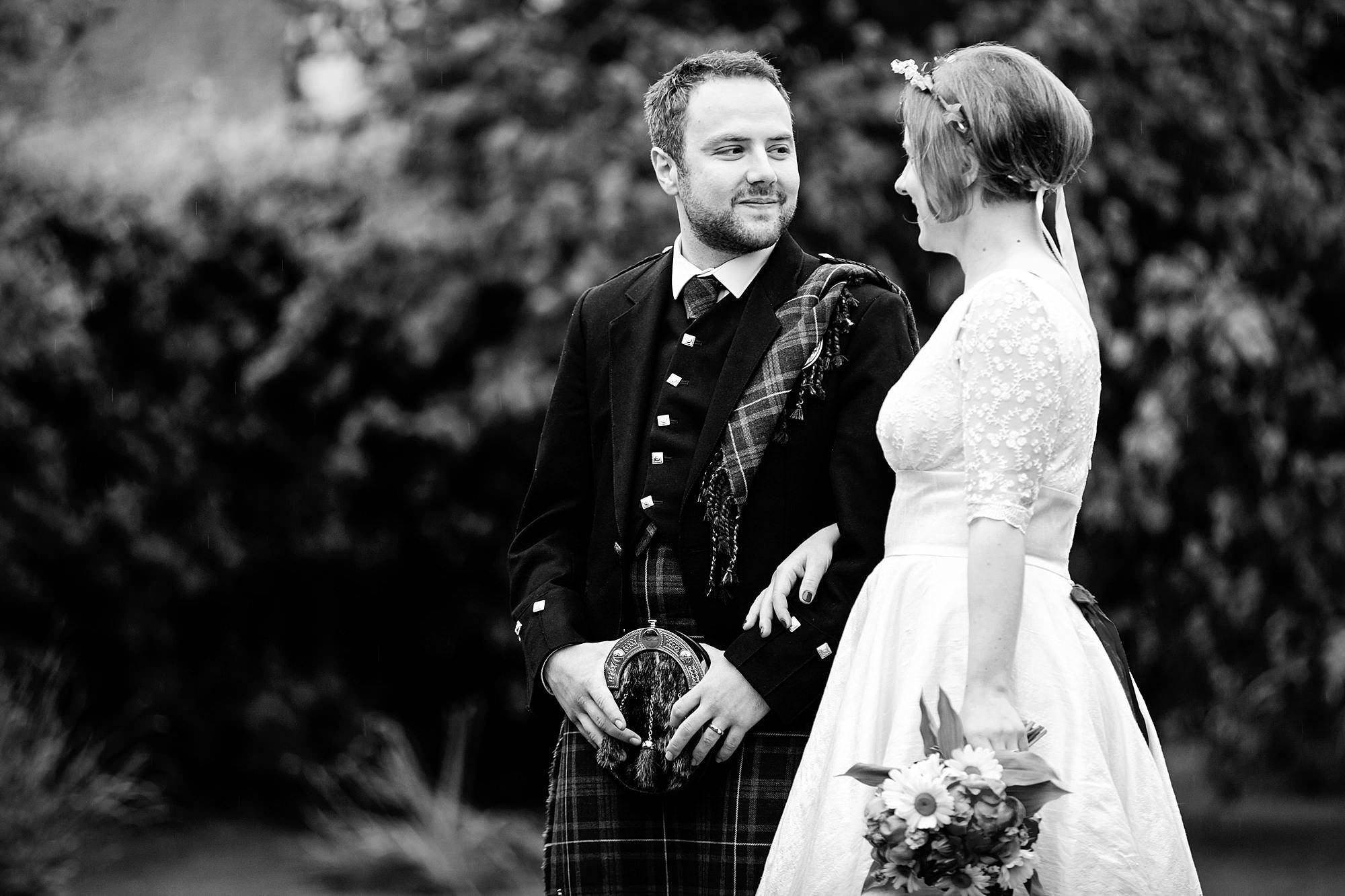 groom looking at his bride at norwood farm wedding