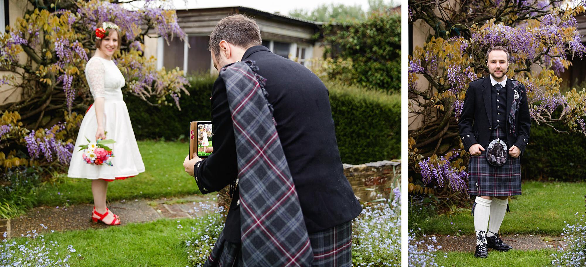 groom takes a photo of his bride at Fun DIY wedding at norwood farm