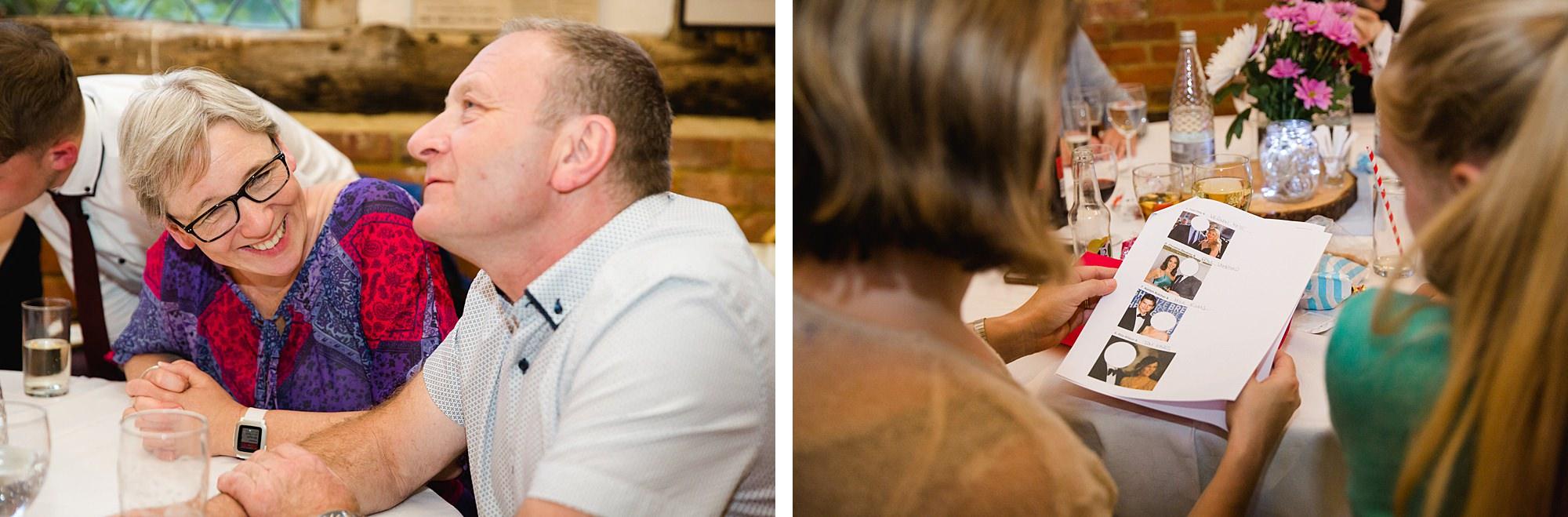 wedding guests considering quiz questions at norwood farm wedding