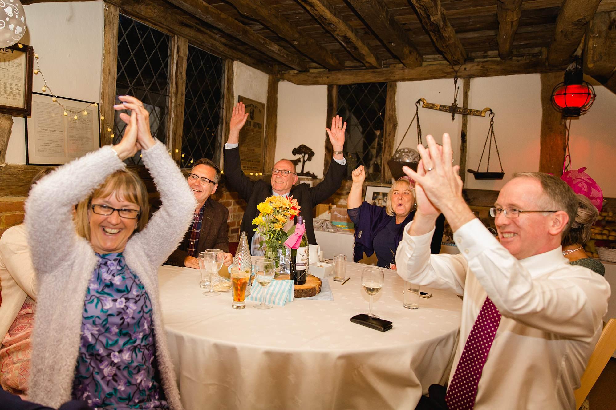 guests cheering as big wedding quiz winners