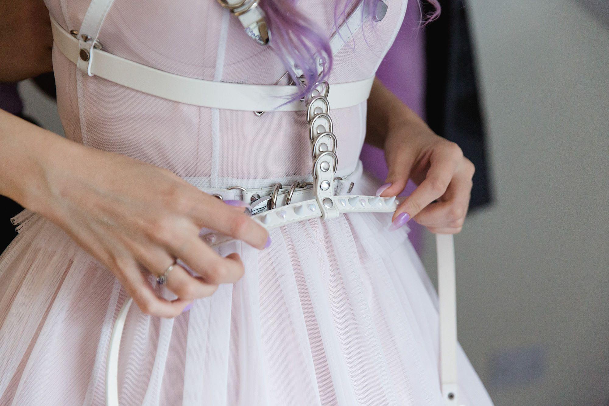 bride fastening wedding dress details