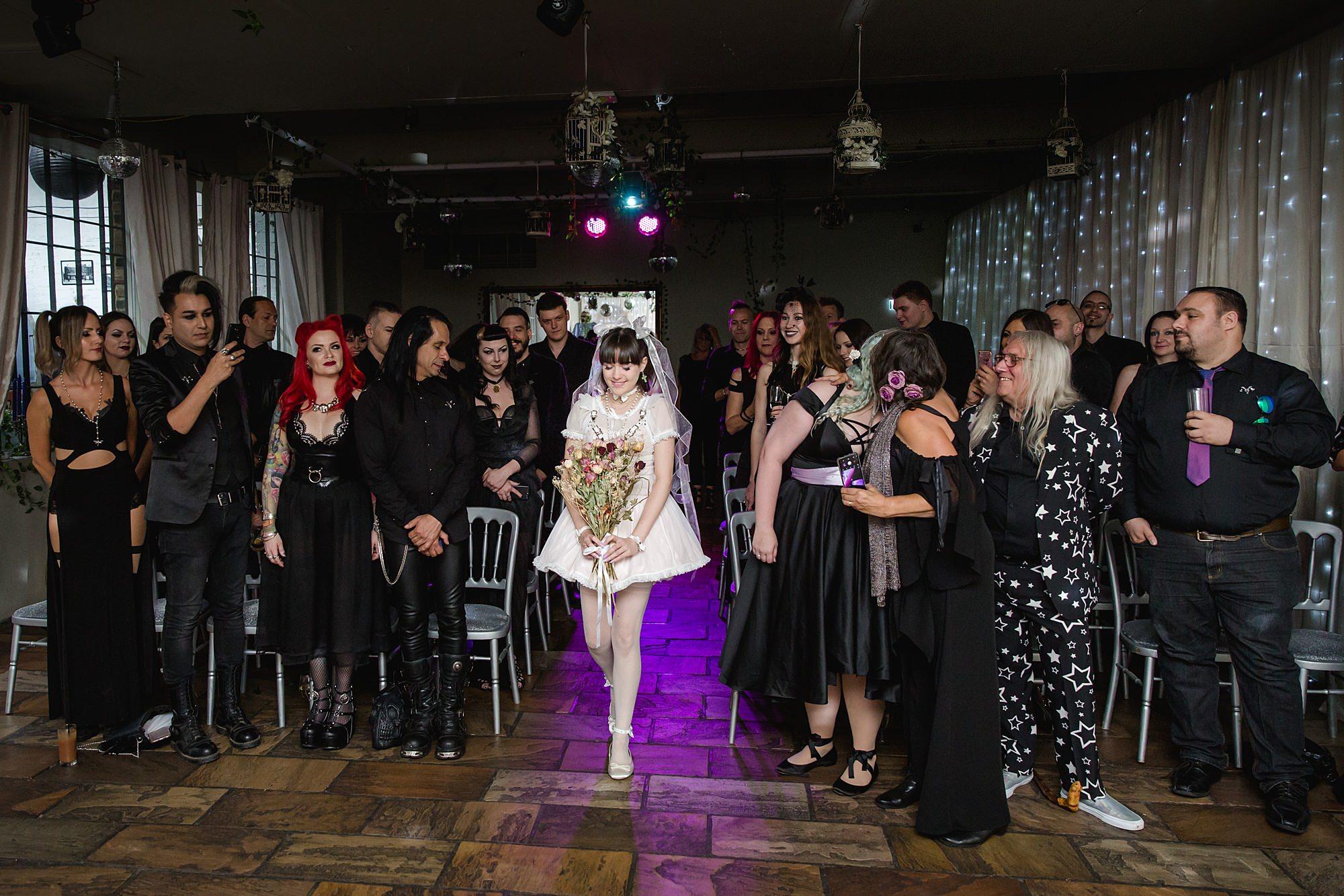 Gothic wedding London bride walks down the aisle at islington metalworks