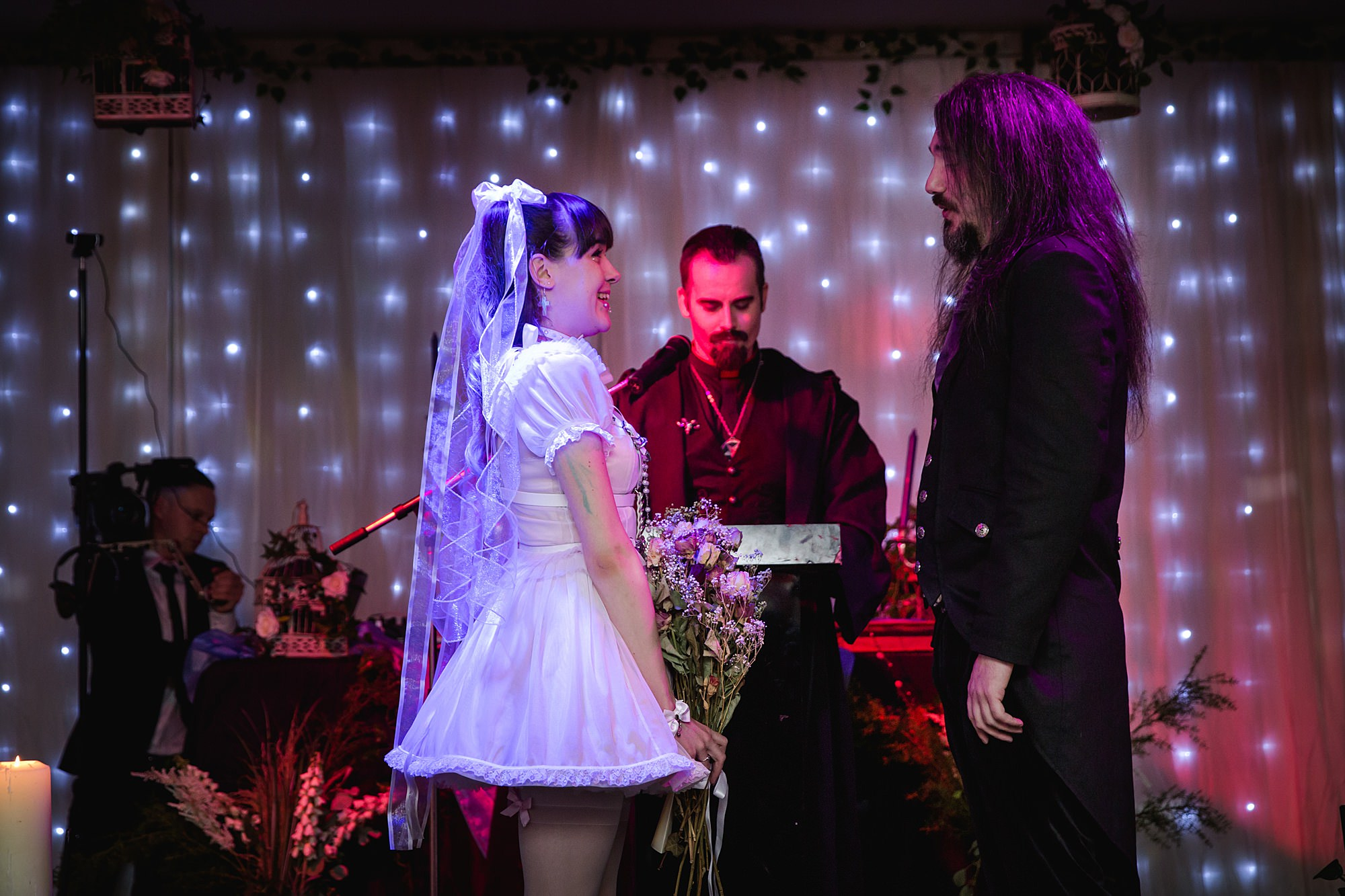 bride greets groom at altar for Gothic wedding London