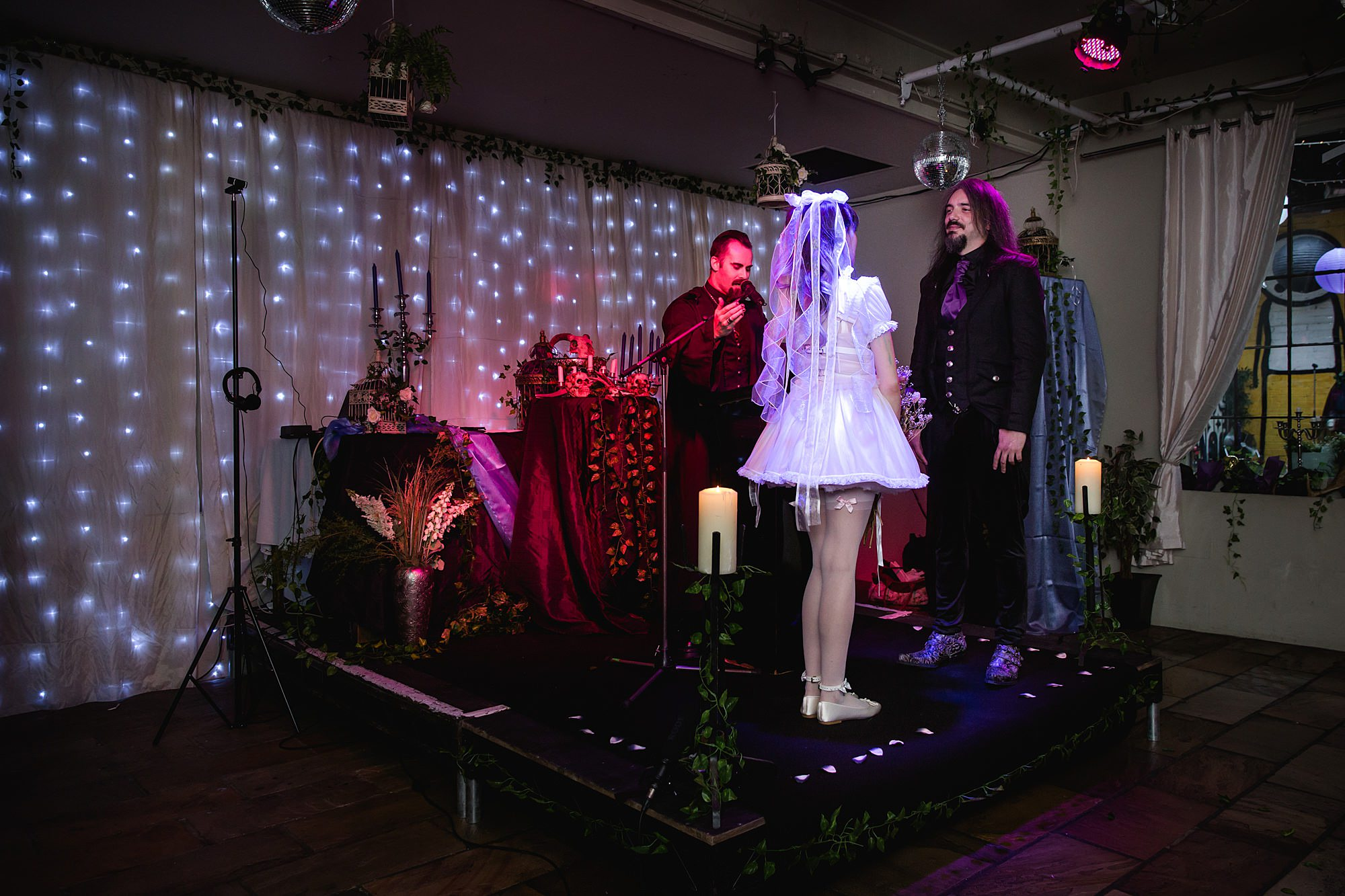 bride and groom at altar with officiant at islington metalworks gothic wedding