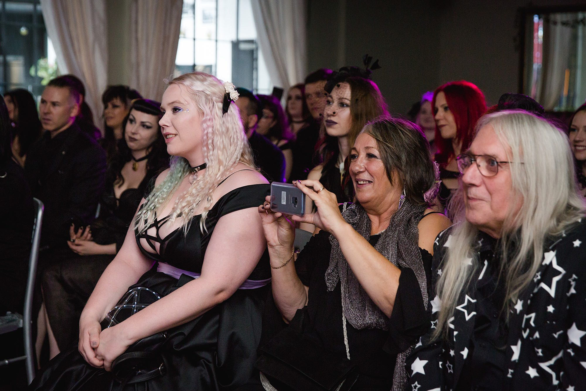 guests enjoying ceremony at london gothic wedding