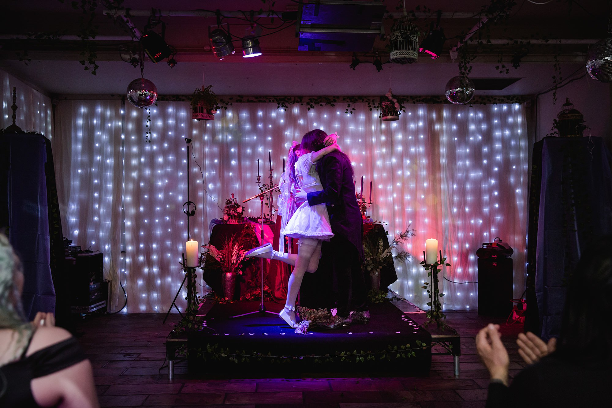 Gothic wedding London bride and groom's first kiss
