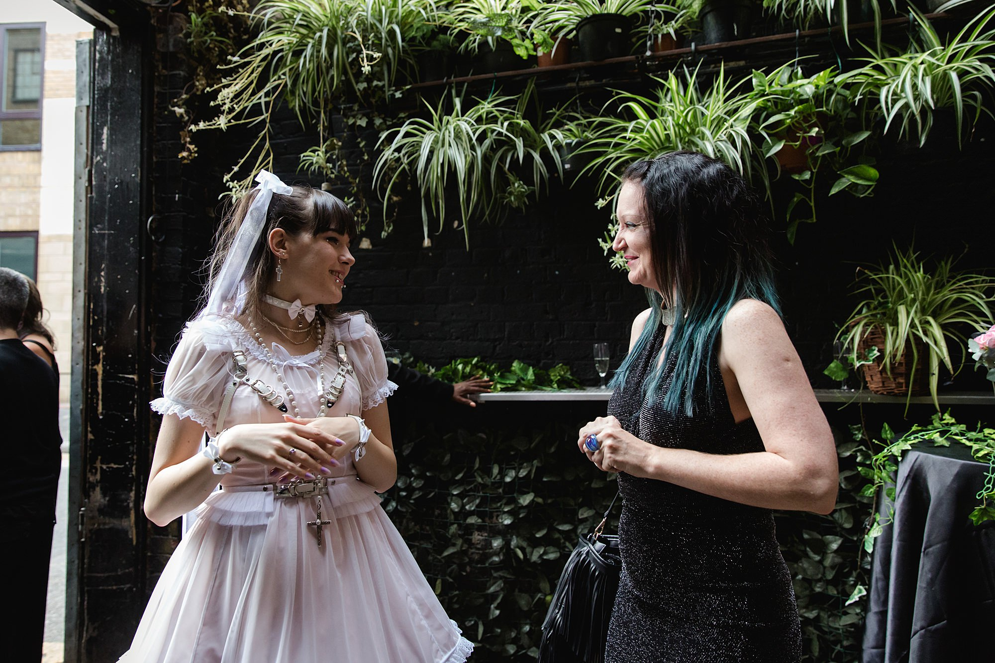 bride chats to a wedding guest at islington metalworks wedding