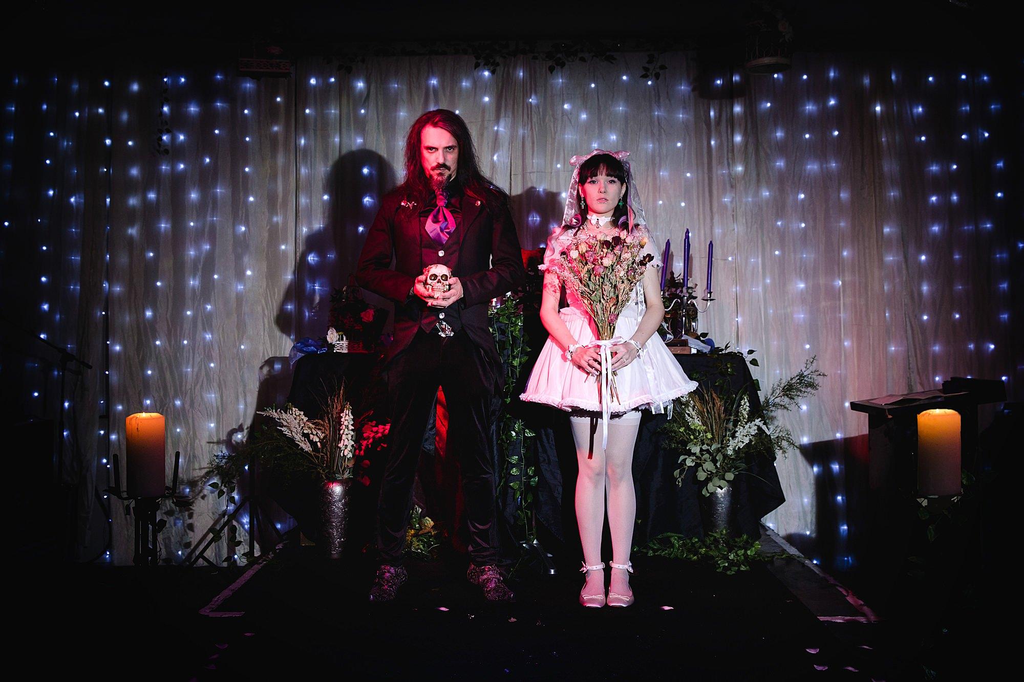 Gothic wedding London bride and groom stood on altar