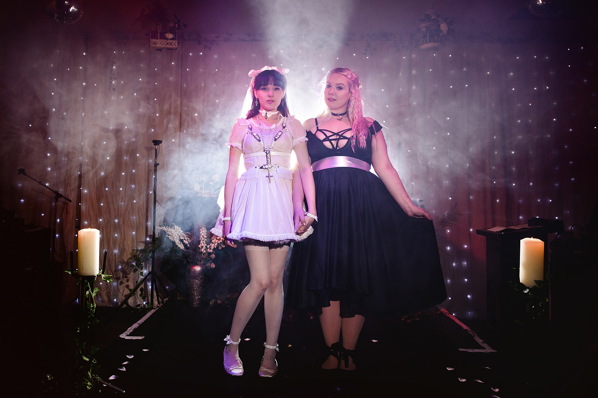 bride and bridesmaid on altar at gothic wedding london