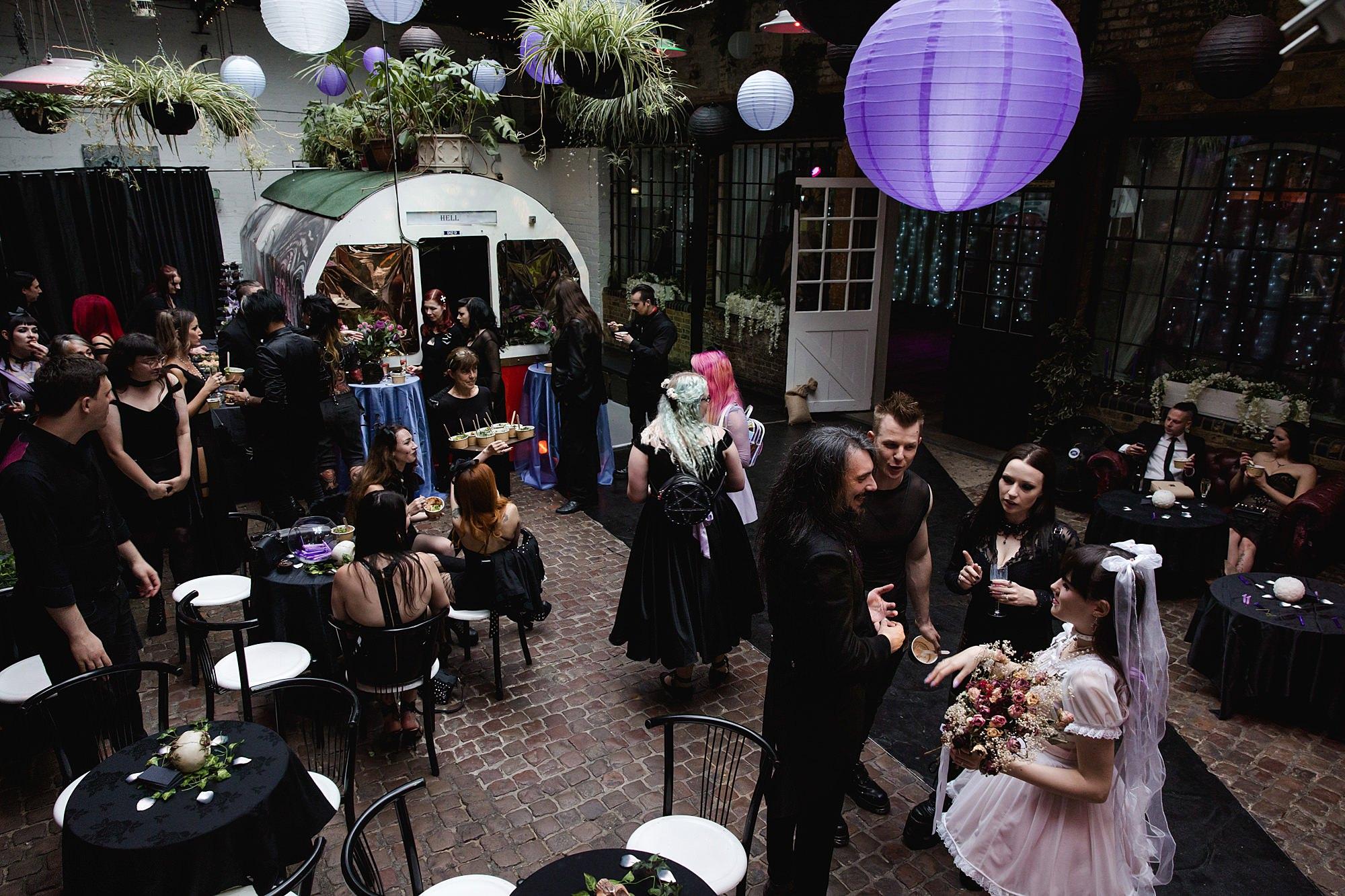 Gothic wedding London guests enjoying drinks reception