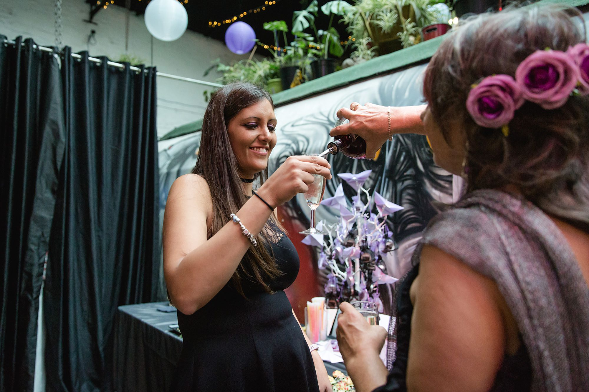 wedding guest pimping their prosecco at gothic wedding