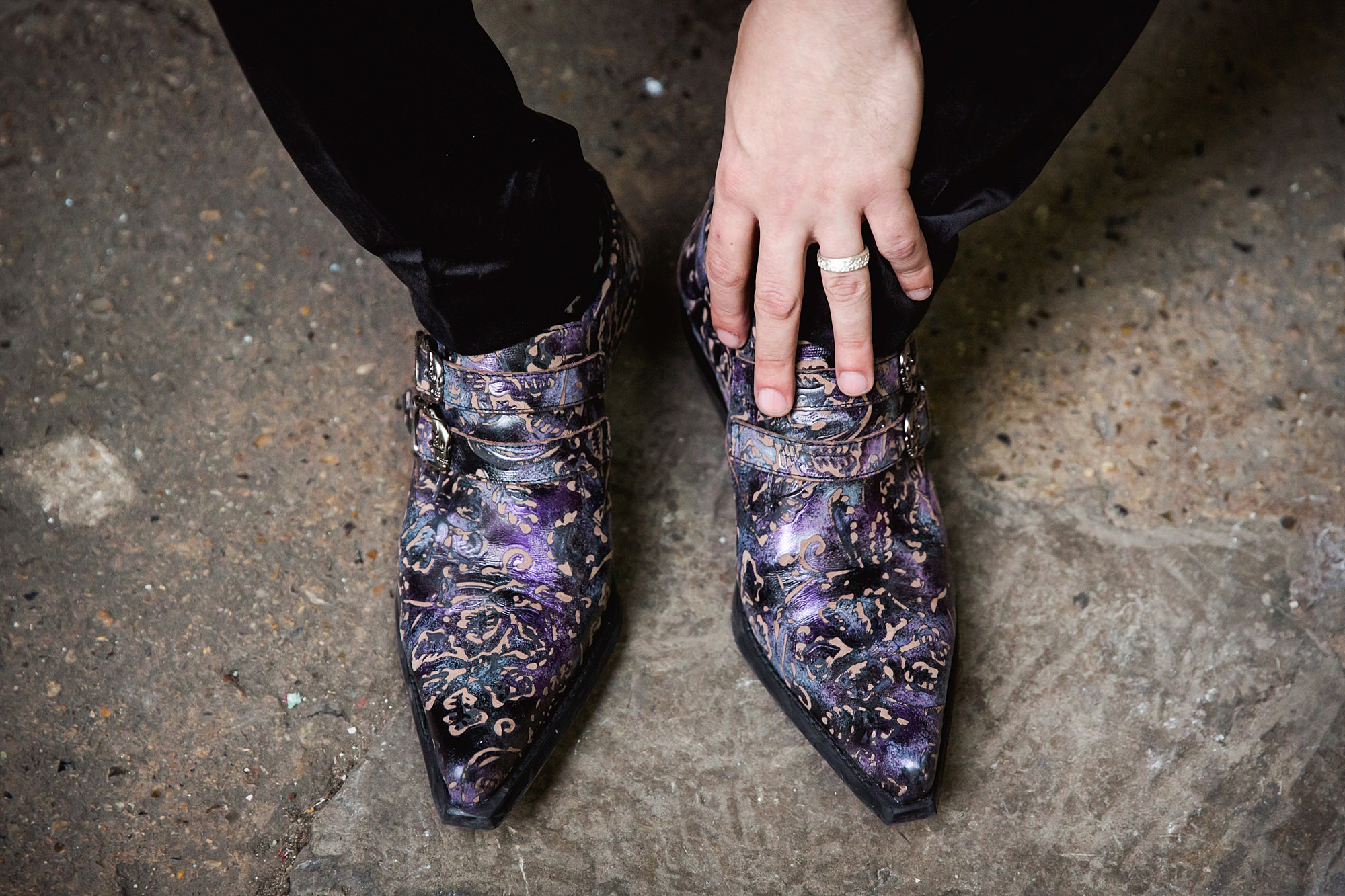 close up detail of groom's purple boots at gothic wedding