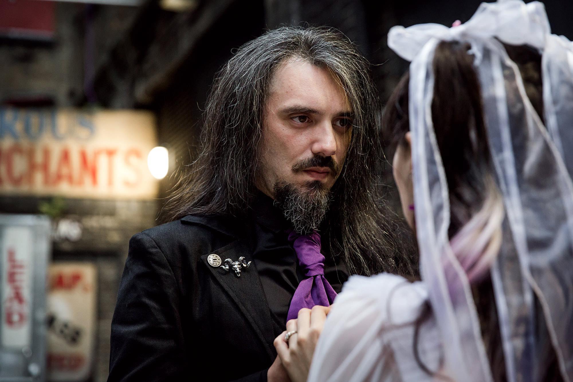 groom looking at bride at gothic wedding london