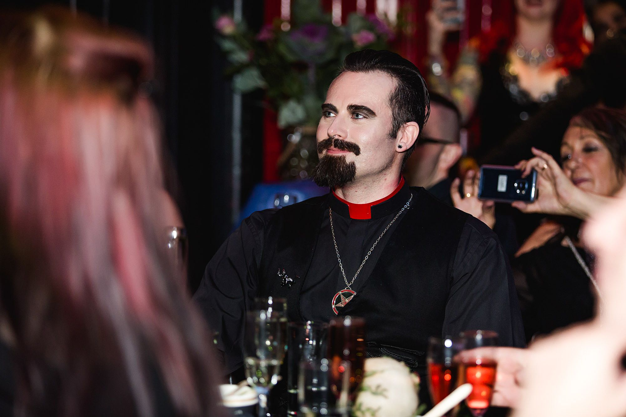 wedding guest listens to speeches at gothic wedding london