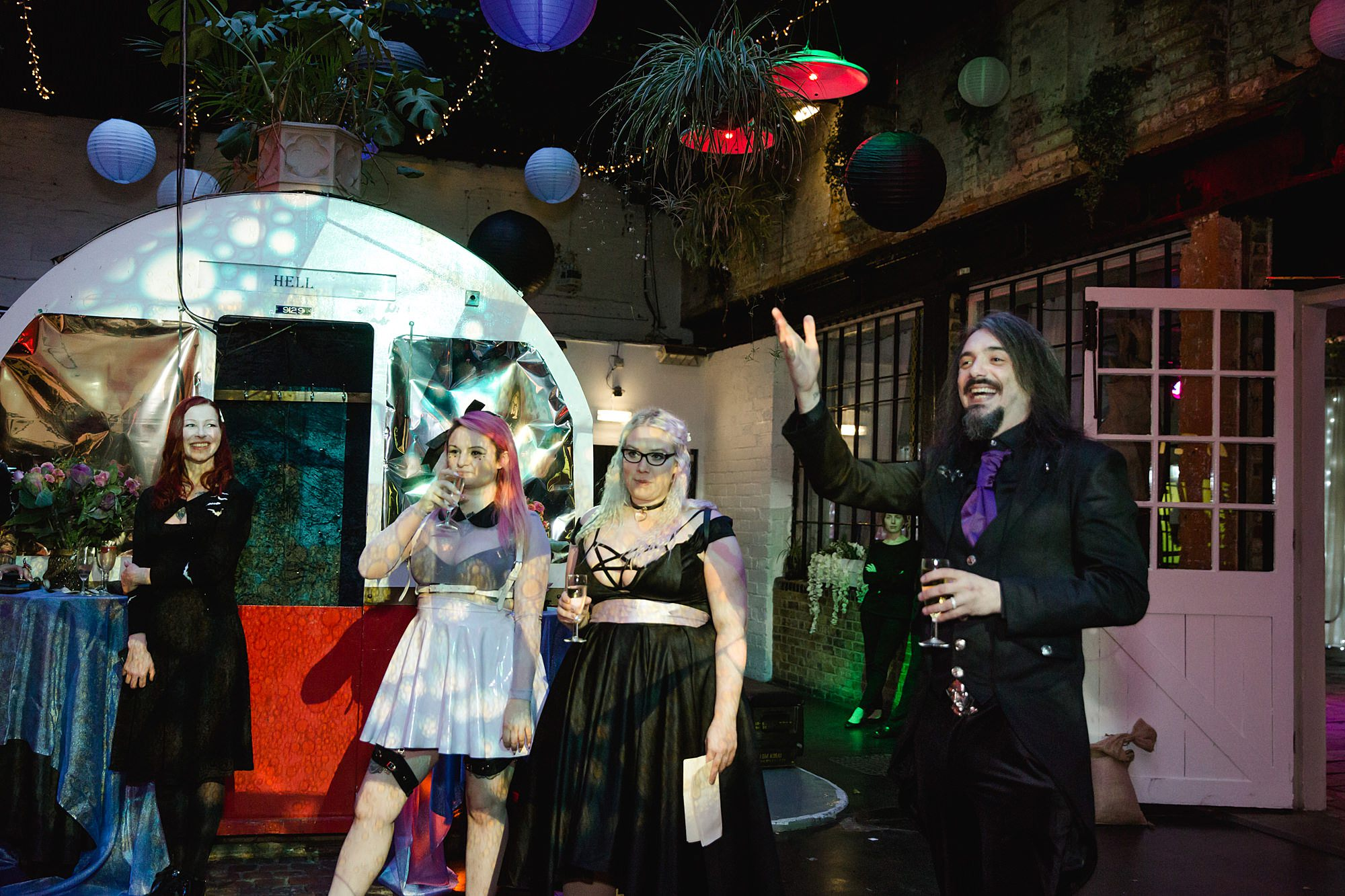 groom cheers during speeches at Gothic wedding London