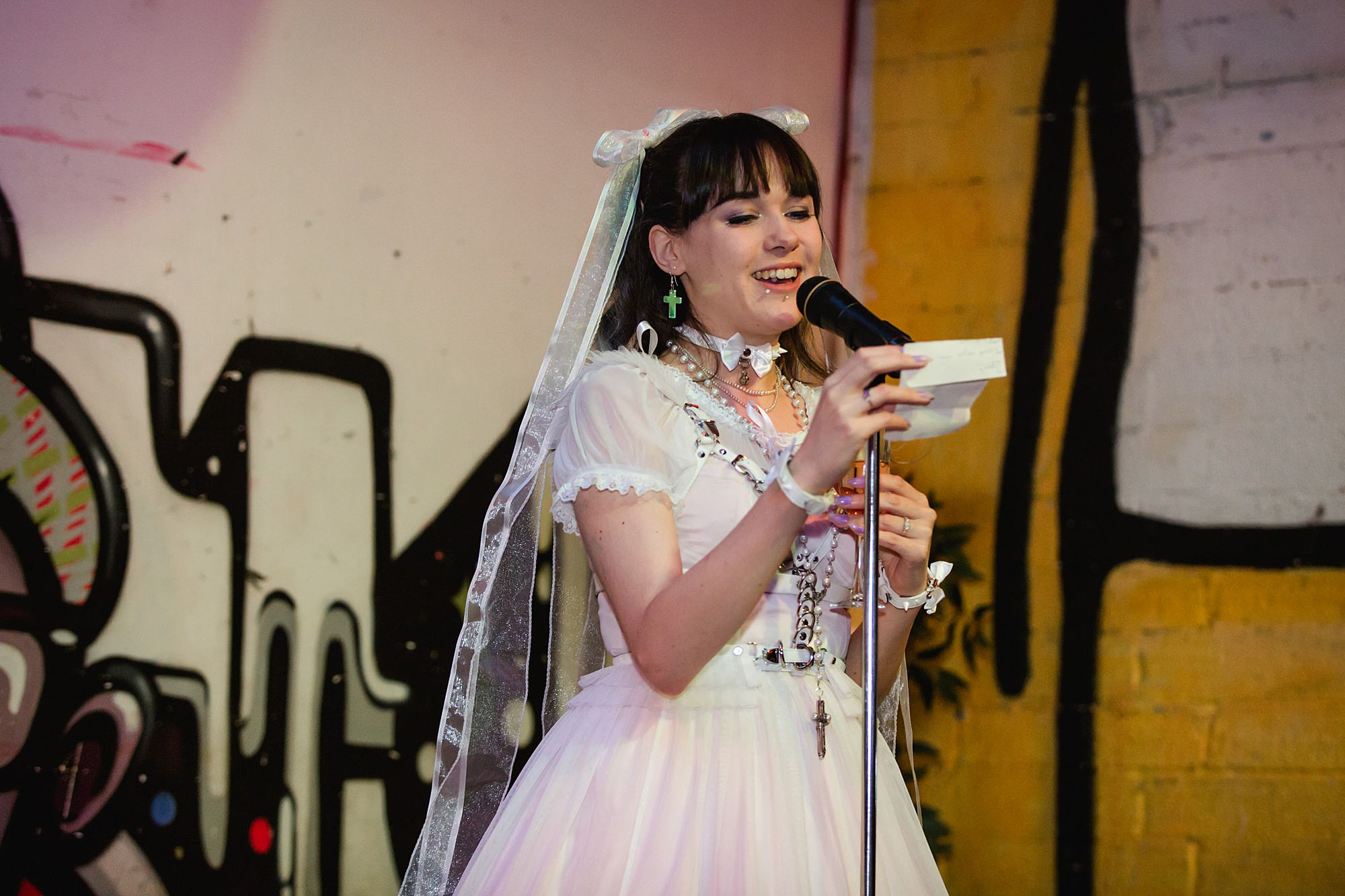 bride gives a speech at Gothic wedding London