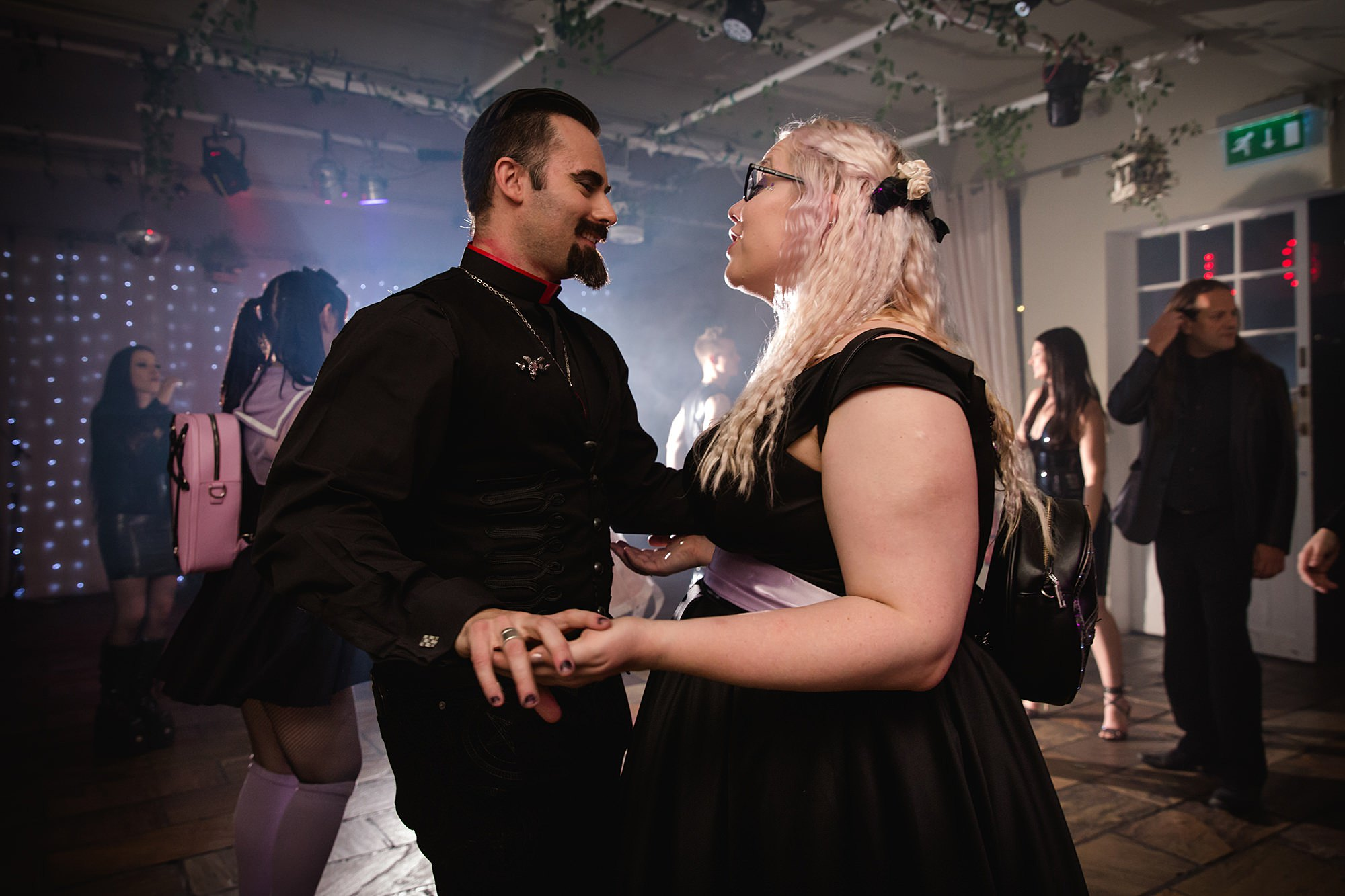 wedding guests dance together at goth wedding london
