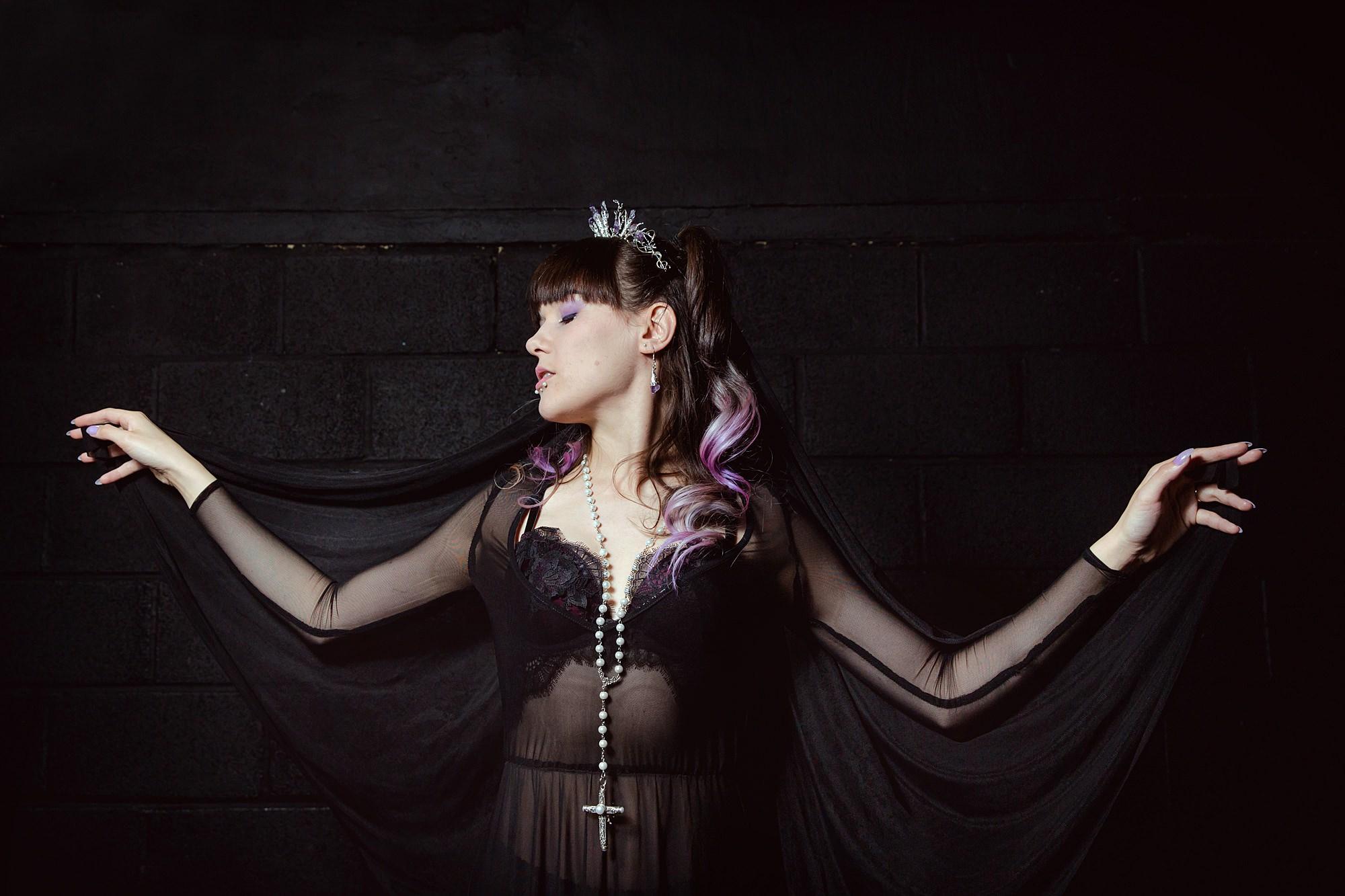 portrait of bride in amethyst crown and black dress at goth wedding