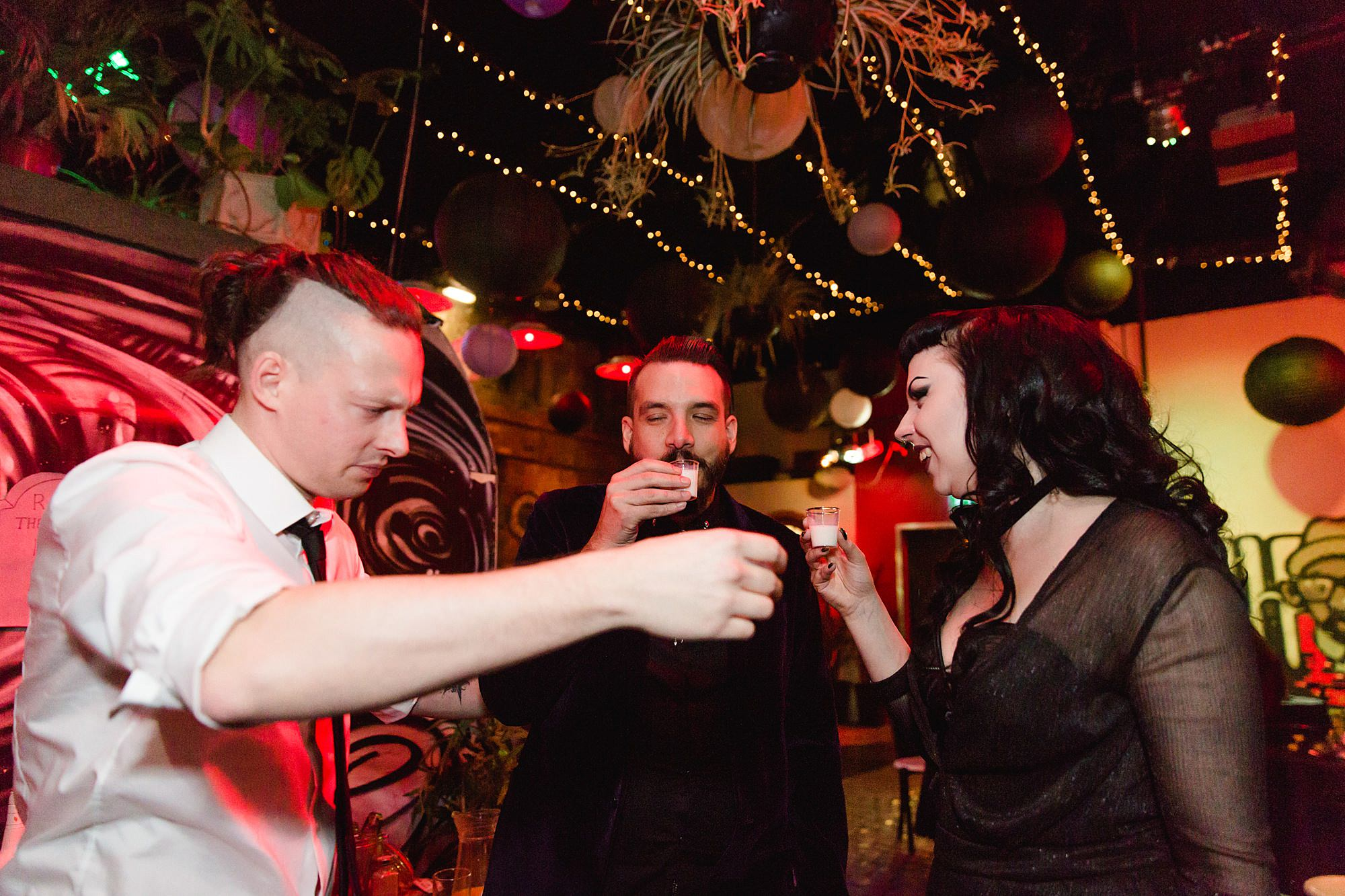 groom doing shots with guests at islington metalworks wedding