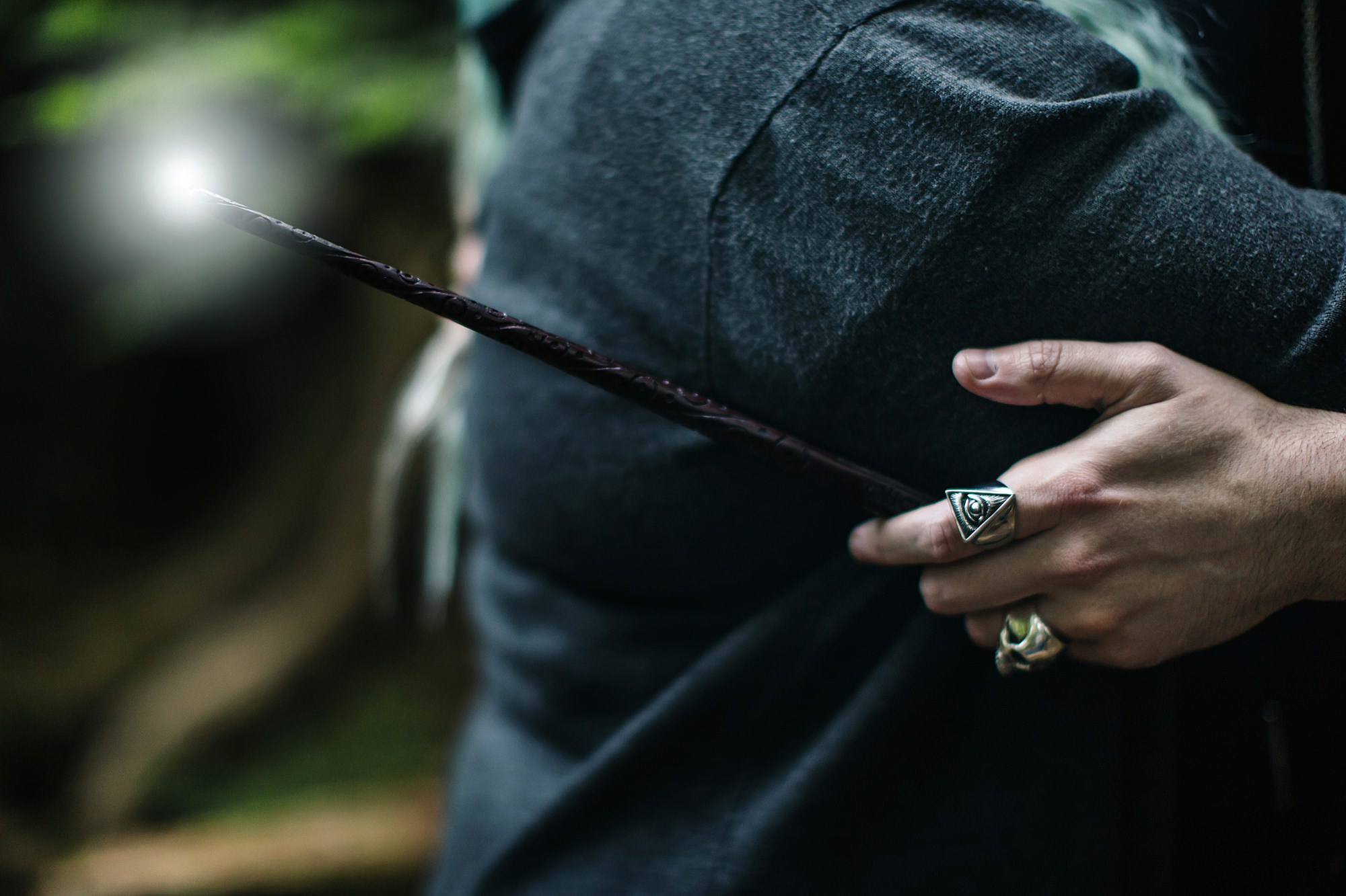 Harry Potter engagement shoot hand holding a wand